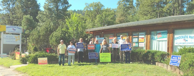 Pictured outside the Democratic Party headquarters in Ruidoso are Frank Thompson, Jean Coulton, Richard Cintron, Judy Foulds, Charmaine O'Rourke, Joyce Westerbur, Linda Perkins, Richard Mastin, Gail Price and Paula Madriles.