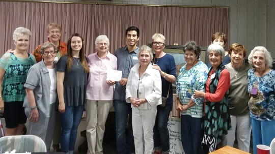 Ruidoso High graduates David Aguirre and Breck Gavin received scholarships from the club's fundraising efforts that included the raffle.