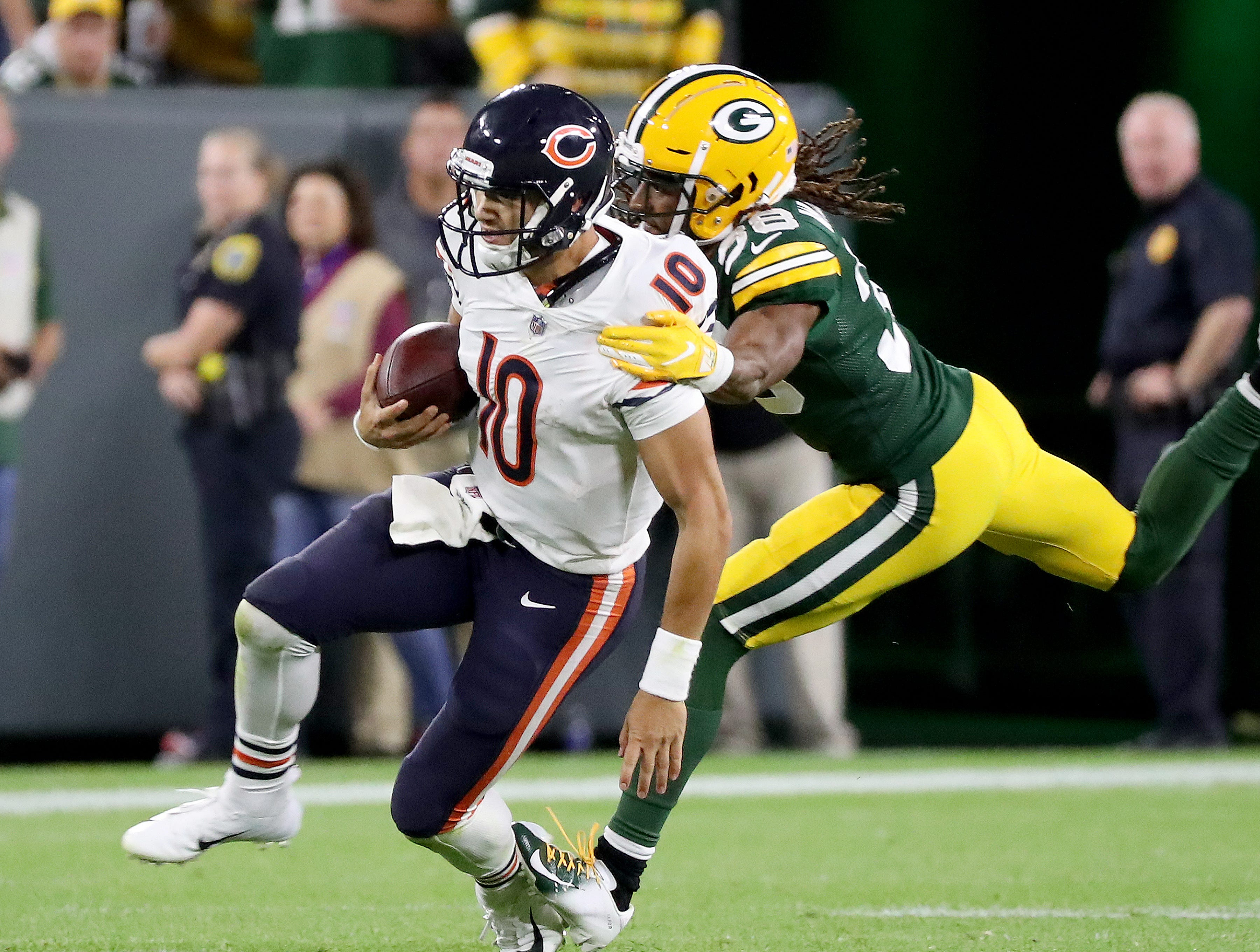 Green Bay Packers defensive back Tramon Williams (38) tackles quarterback Mitchell Trubisky (10) against the Chicago Bears Sunday, September 9, 2018 at Lambeau Field in Green Bay, Wis.
