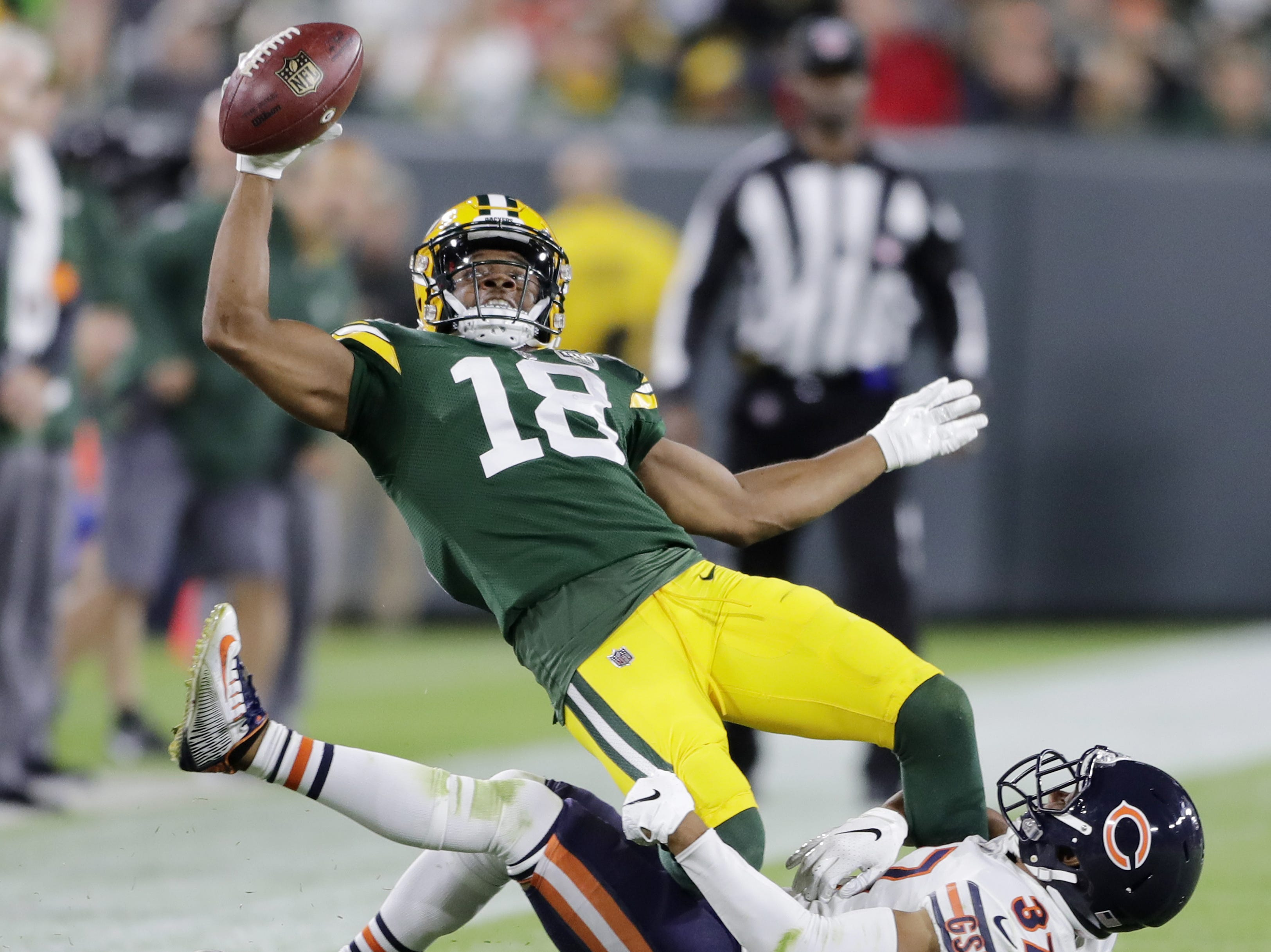 Green Bay Packers wide receiver Randall Cobb (18) reaches out for a first down in the third quarter against the Chicago Bears at Lambeau Field on Sunday, September 9, 2018 in Green Bay, Wis.