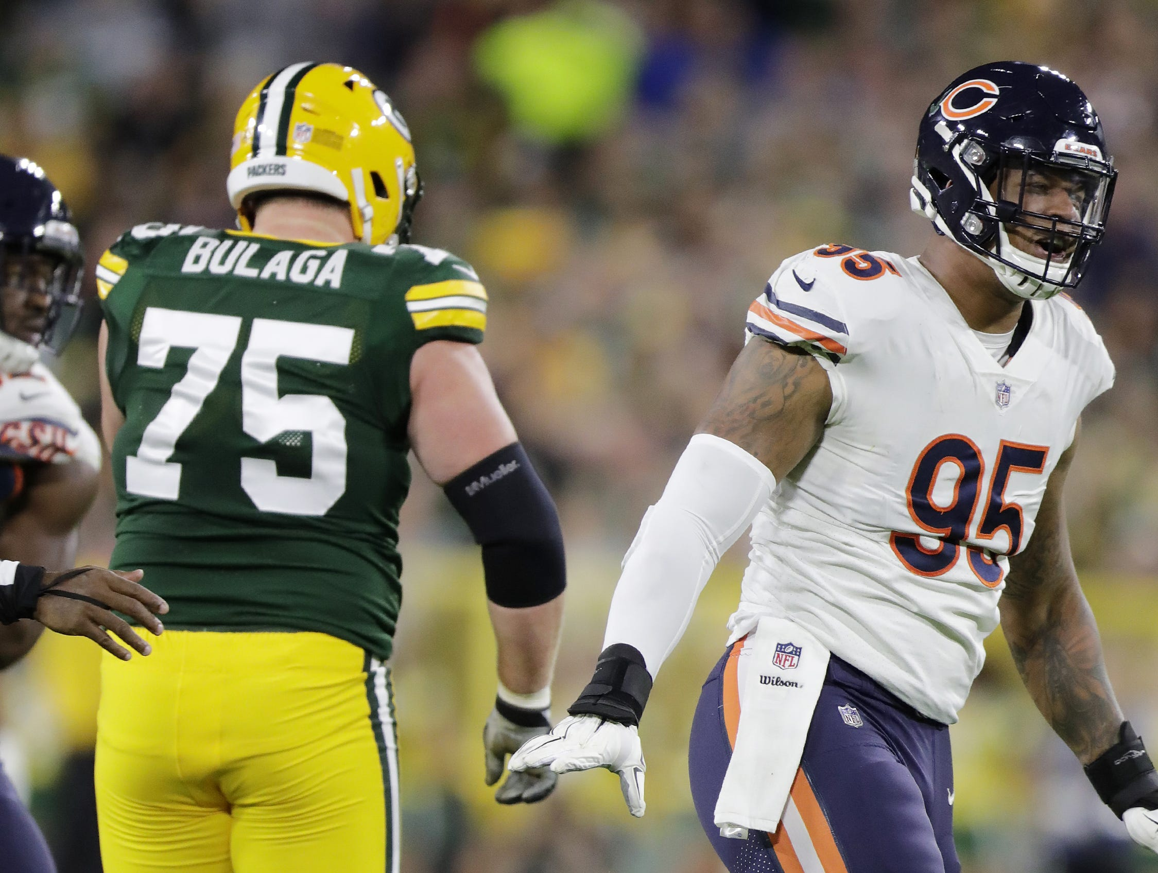 Chicago Bears defensive end Roy Robertson-Harris (95) reacts after sacking Green Bay Packers quarterback Aaron Rodgers (12) in the second quarter at Lambeau Field on Sunday, September 9, 2018 in Green Bay, Wis.