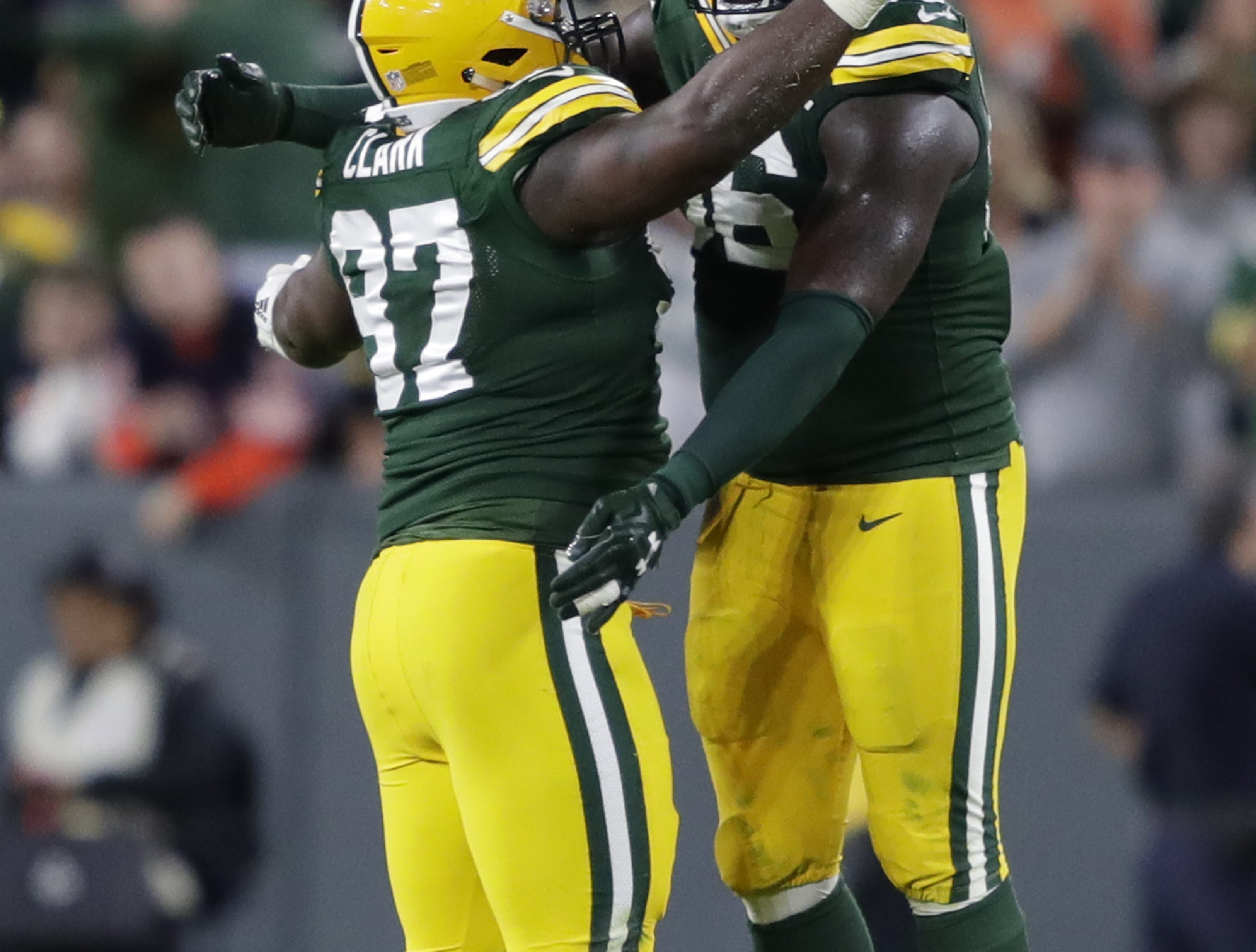 Green Bay Packers nose tackle Kenny Clark (97) celebrates recovering a fumble with teammate Muhammad Wilkerson (96) in the fourth quarter against the Chicago Bears Sunday, Sept. 9, 2018, at Lambeau Field in Green Bay, Wis.