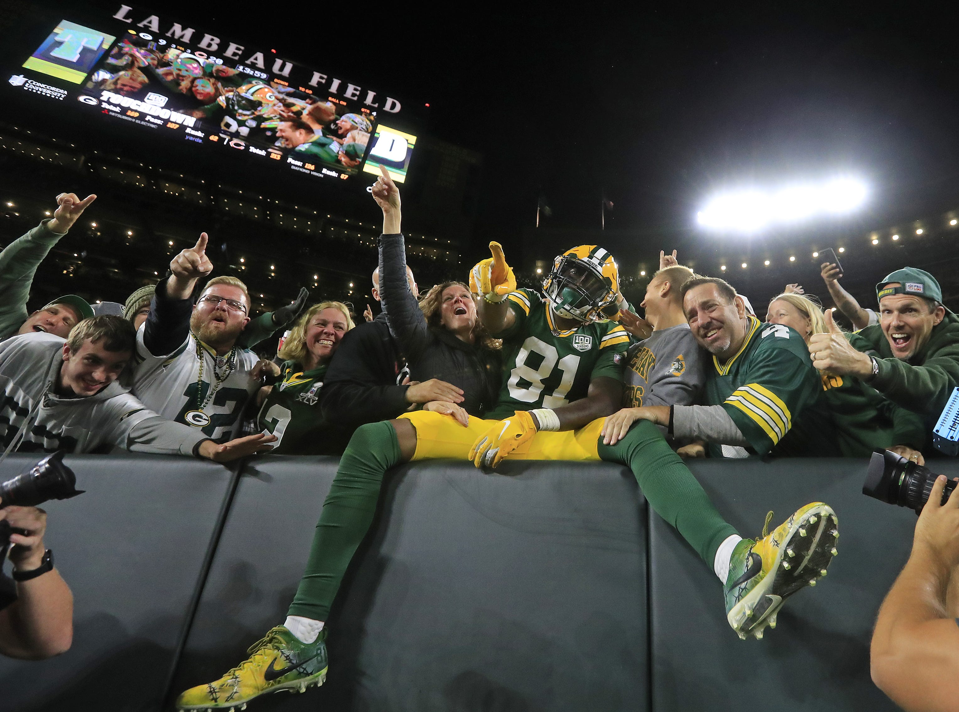 Green Bay Packers wide receiver Geronimo Allison (81) takes a Lambeau leap after scoring a touchdown against the Chicago Bears in the fourth quarter at Lambeau Field on Sunday, September 9, 2018 in Green Bay, Wis.