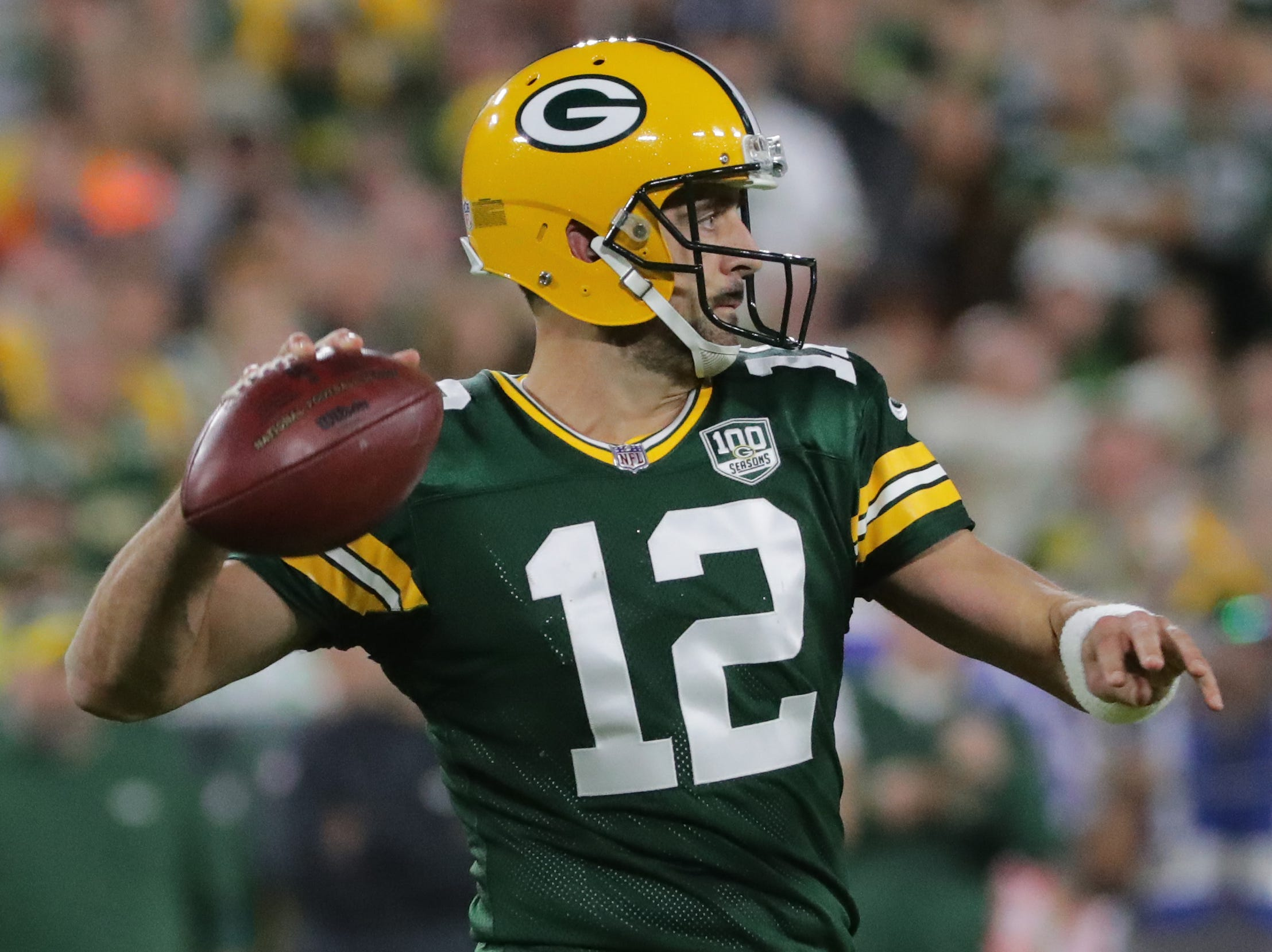 Green Bay Packers quarterback Aaron Rodgers (12) rifles a pass after re-eentering the game for the first series in the third quarter of their game against the Chicago Bears Sunday, September 9, 2018 at Lambeau Field in Green Bay, Wis. Rodgers had been carted off the field during the second quarter after hit by Chicago Bears defensive end Roy Robertson-Harris.