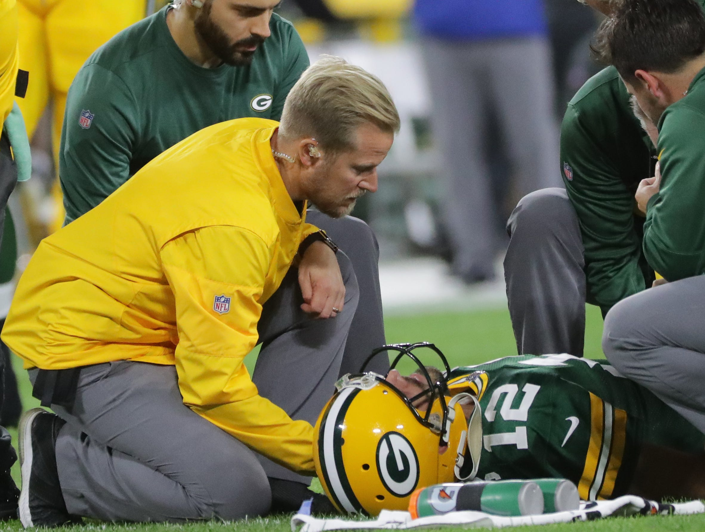 Green Bay Packers quarterback Aaron Rodgers (12) is tended to by the training staff after being injured during the second quarter of their game against the Chicago Bears Sunday, September 9, 2018 at Lambeau Field in Green Bay, Wis.