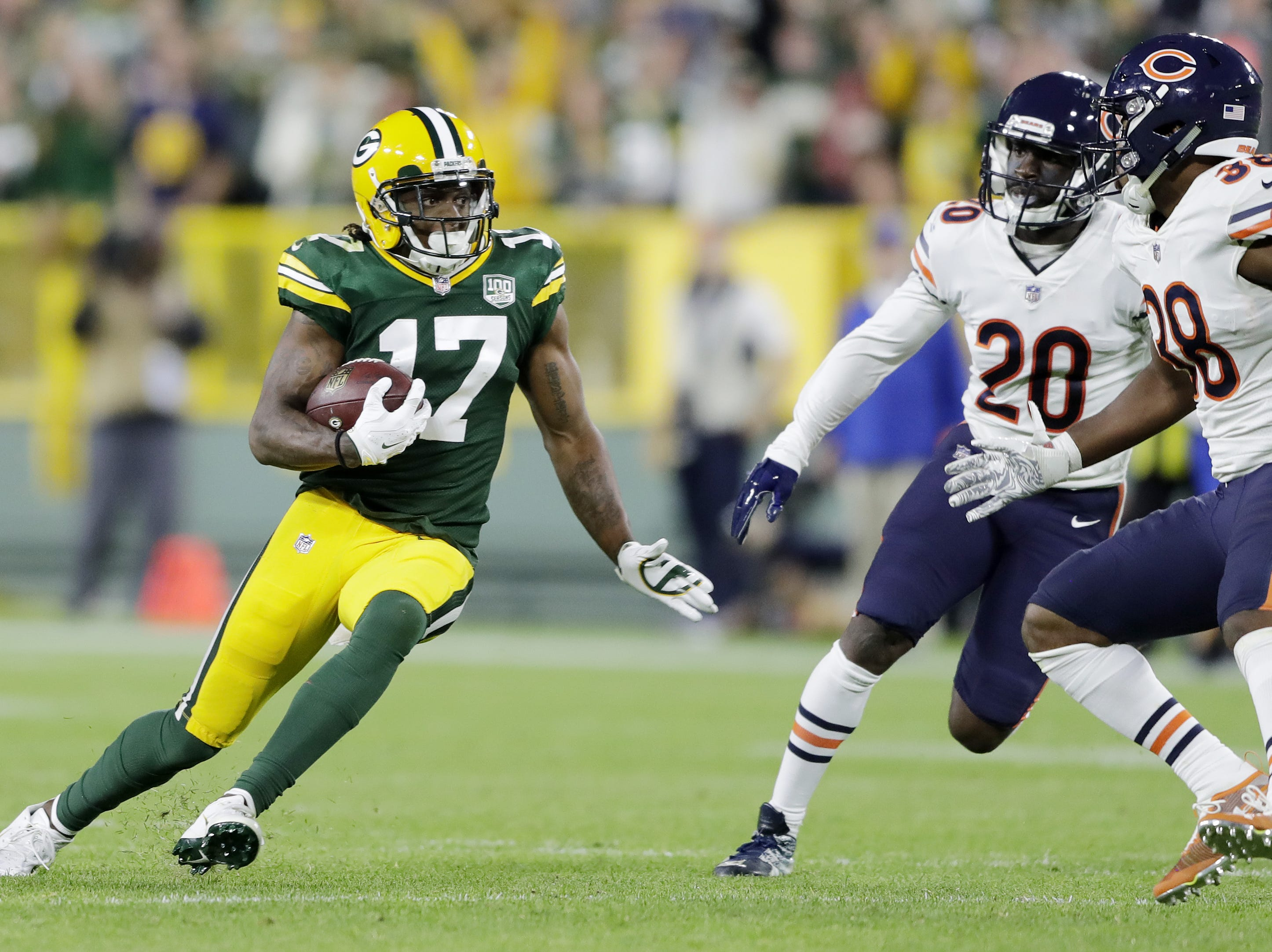 Green Bay Packers wide receiver Davante Adams (17) runs after a catch to score a touchdown against the Chicago Bears in the fourth quarter at Lambeau Field on Sunday, September 9, 2018 in Green Bay, Wis.