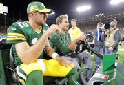 Packers quarterback Aaron Rodgers is carted off the field following a second-quarter injury against the Chicago Bears in the 2018 season opener at Lambeau Field