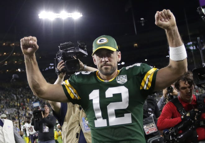 Green Bay Packers quarterback Aaron Rodgers (12) celebrates a 24-23 victory against the Chicago Bears Sunday, Sept. 9, 2018, at Lambeau Field in Green Bay, Wis.