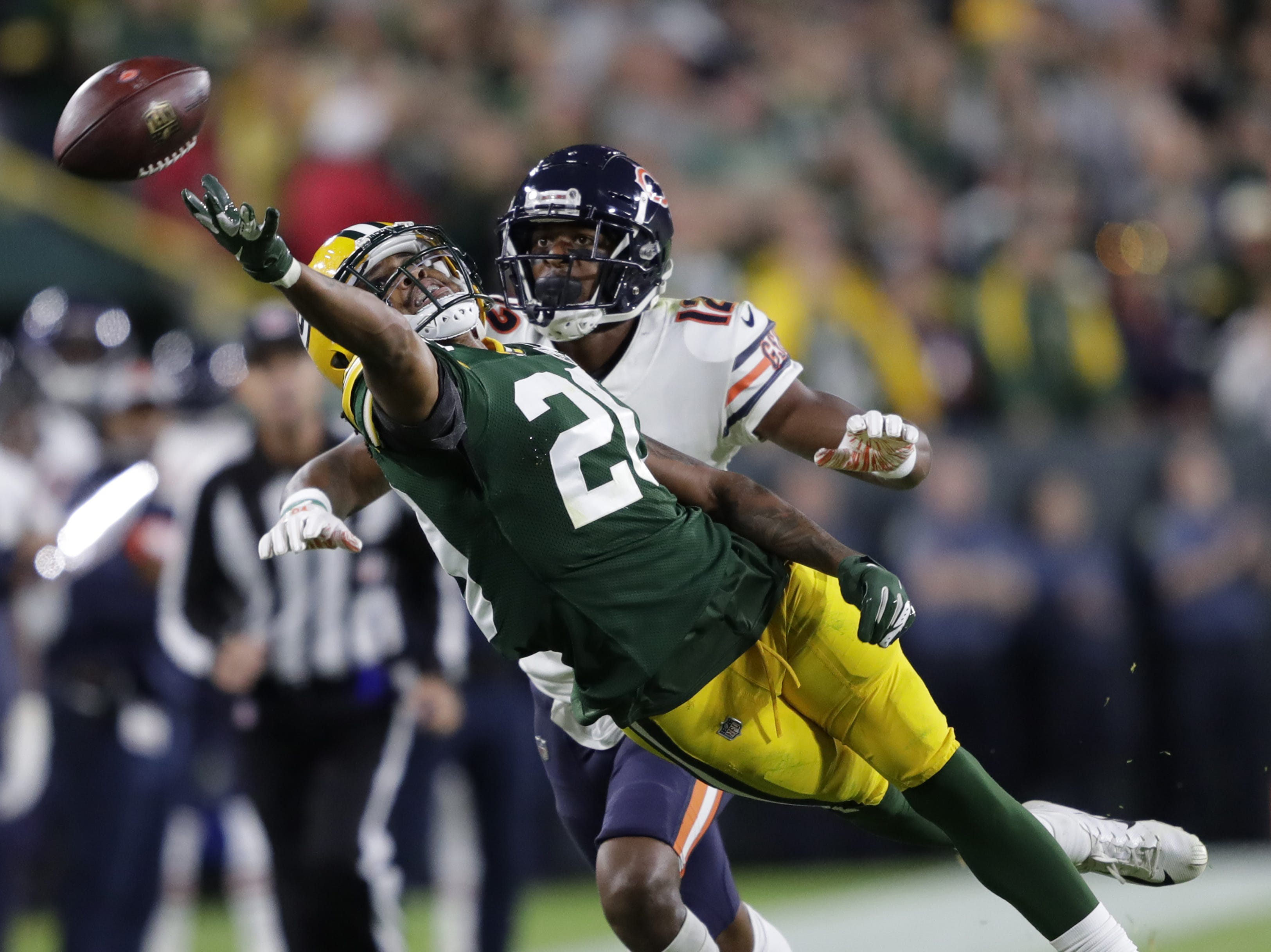 Green Bay Packers cornerback Kevin King (20) tries to intercept a pass intended to Chicago Bears wide receiver Allen Robinson (12) in the fourth quarter Sunday, Sept. 9, 2018, at Lambeau Field in Green Bay, Wis.
