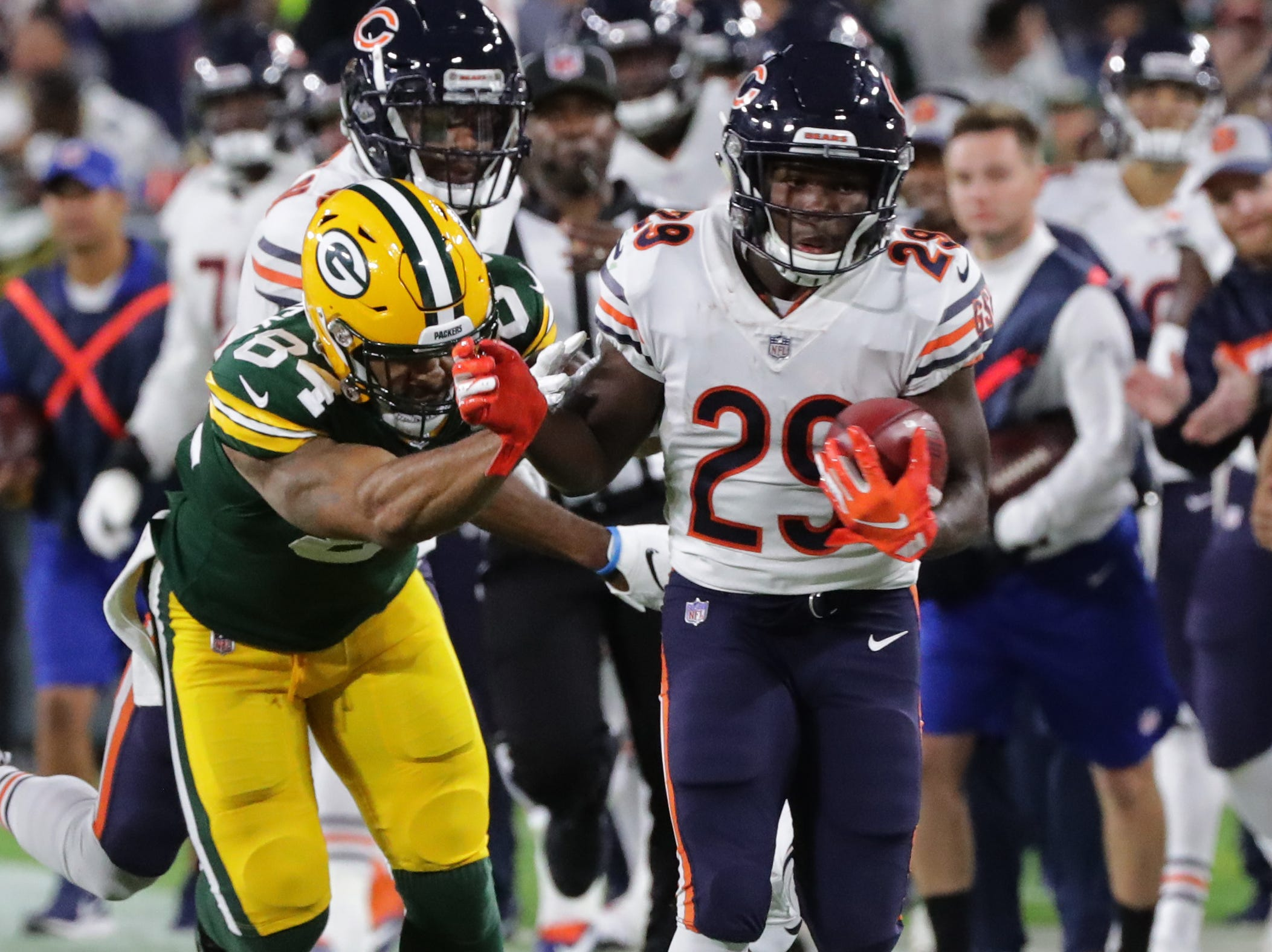 Chicago Bears running back Tarik Cohen (29) returns a punt for 42 yard during the second quarter of their game against the Green Bay Packers Sunday, September 9, 2018 at Lambeau Field in Green Bay, Wis.