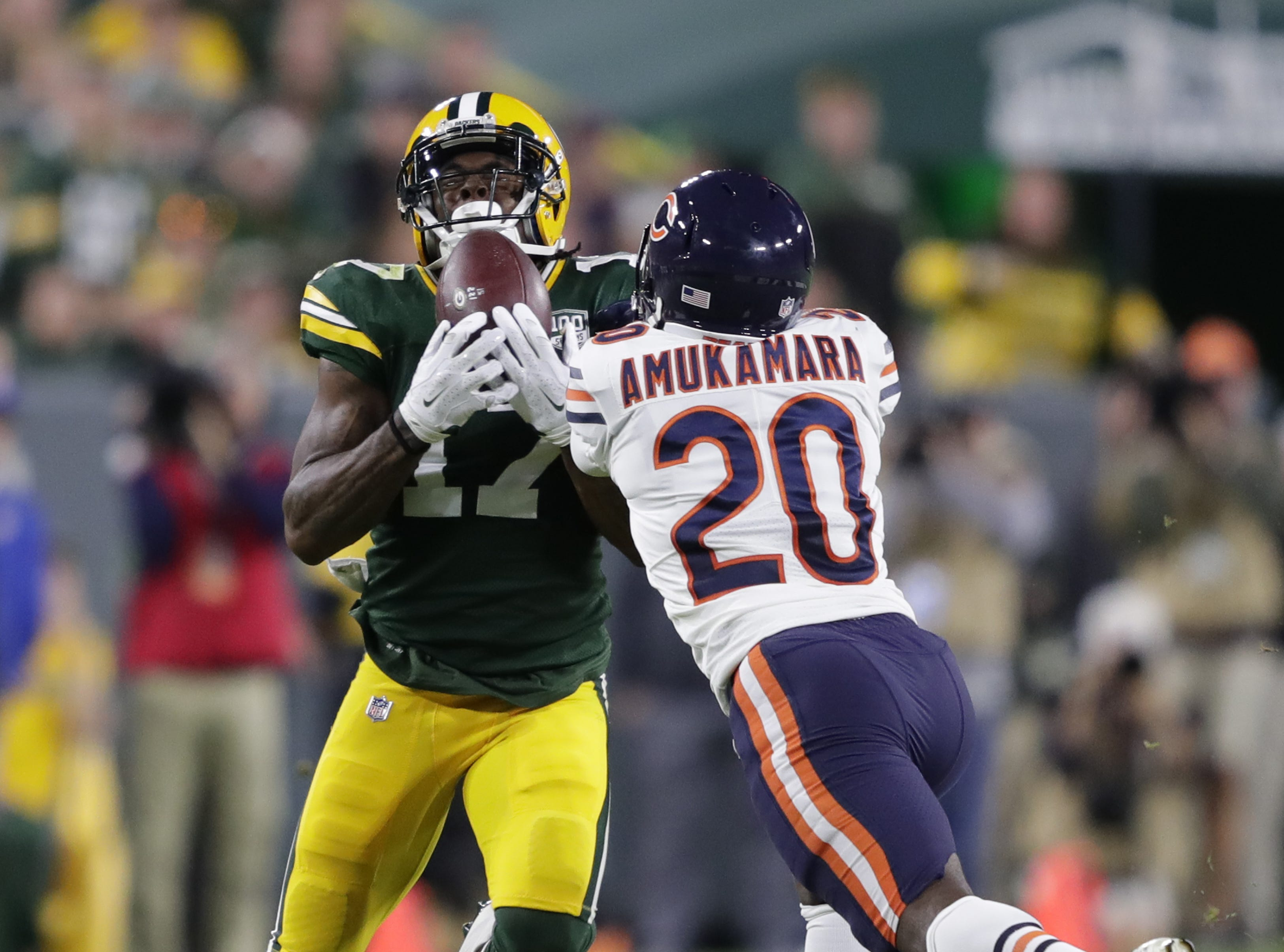Green Bay Packers wide receiver Davante Adams (17) hauls in a long reception against Chicago Bears defensive back Prince Amukamara in the fourth quarter Sunday, Sept. 9, 2018, at Lambeau Field in Green Bay, Wis.