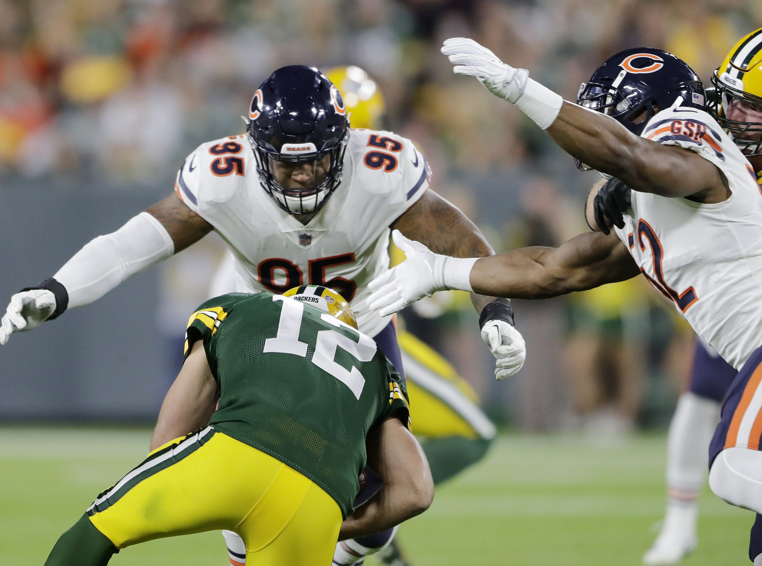 Green Bay Packers quarterback Aaron Rodgers (12) is sacked by Chicago Bears defensive end Roy Robertson-Harris (95) and linebacker Khalil Mack (52) in the second quarter at Lambeau Field on Sunday, September 9, 2018 in Green Bay, Wis.