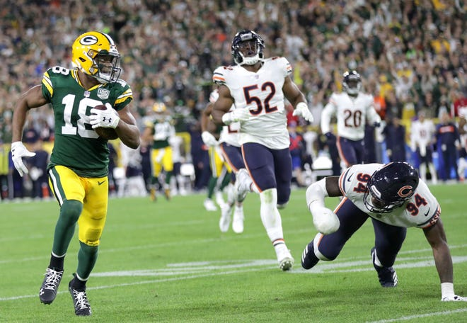 Green Bay Packers' Randall Cobb scores the go ahead touchdown on a catch and run reception in the fourth quarter against the Chicago Bears in the season opener on Sunday, September 9, 2018, at Lambeau Field in Green Bay, Wis. The Packers dfeated the Bears 24 to 23.
