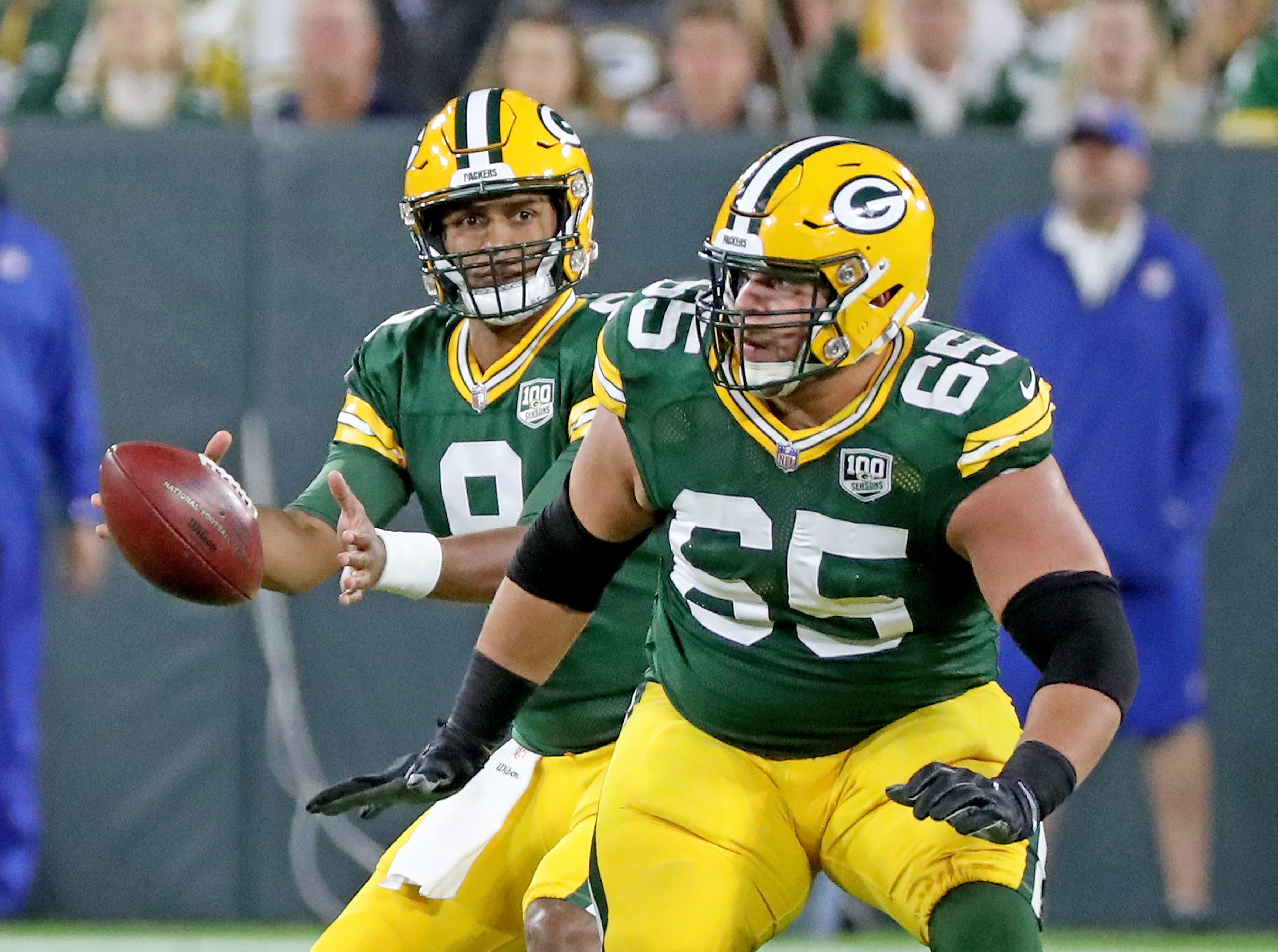 Green Bay Packers quarterback DeShone Kizer (9) takes the snap as offensive guard Lane Taylor (65) blocks against the Chicago Bears Sunday, September 9, 2018 at Lambeau Field in Green Bay, Wis. Jim Matthews/USA TODAY NETWORK-Wisconsin