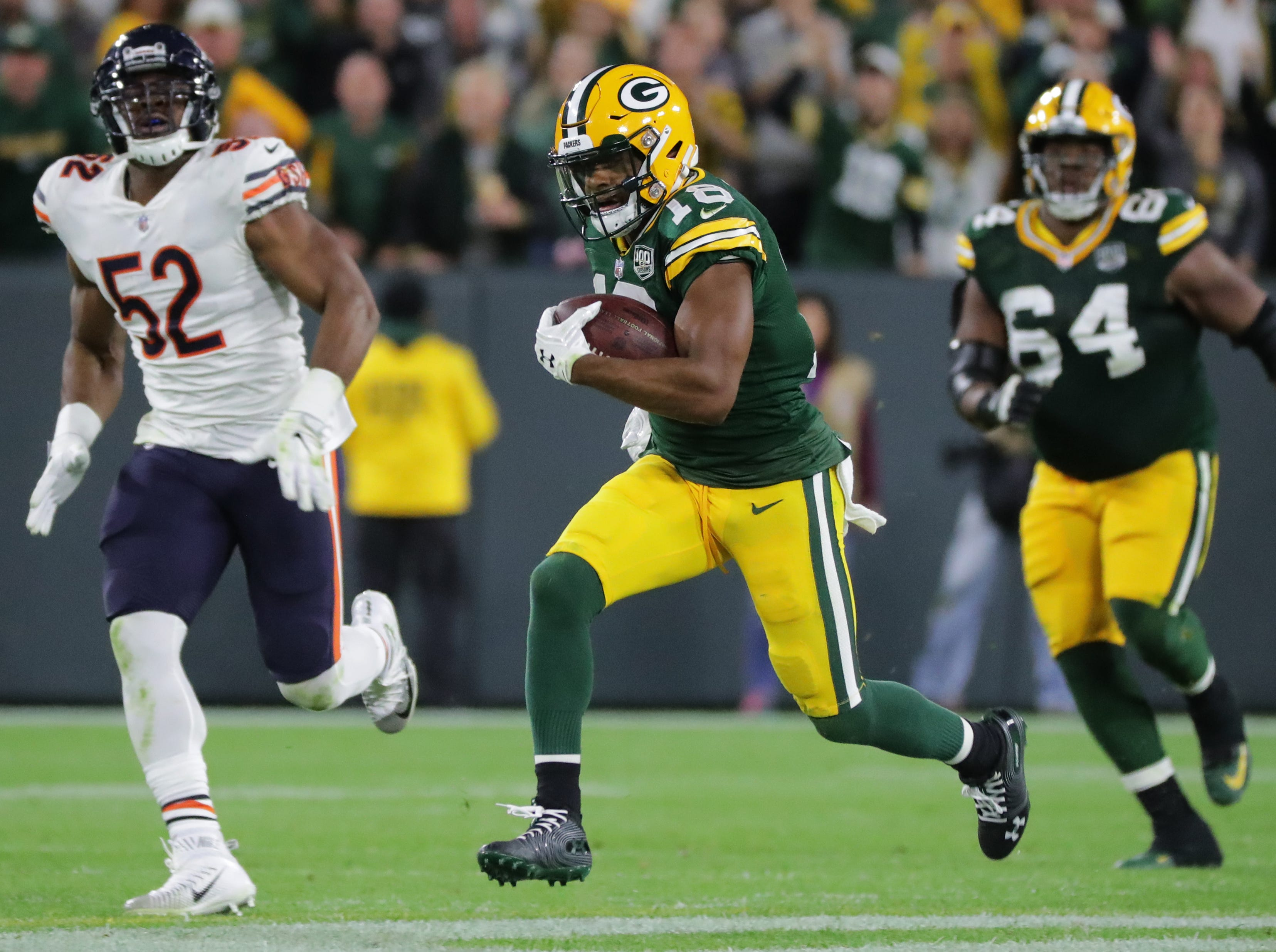 Green Bay Packers wide receiver Randall Cobb (18) scores a touchdown on a 75-yard reception during the fourth quarter of their game against the Chicago Bears Sunday, September 9, 2018 at Lambeau Field in Green Bay, Wis.