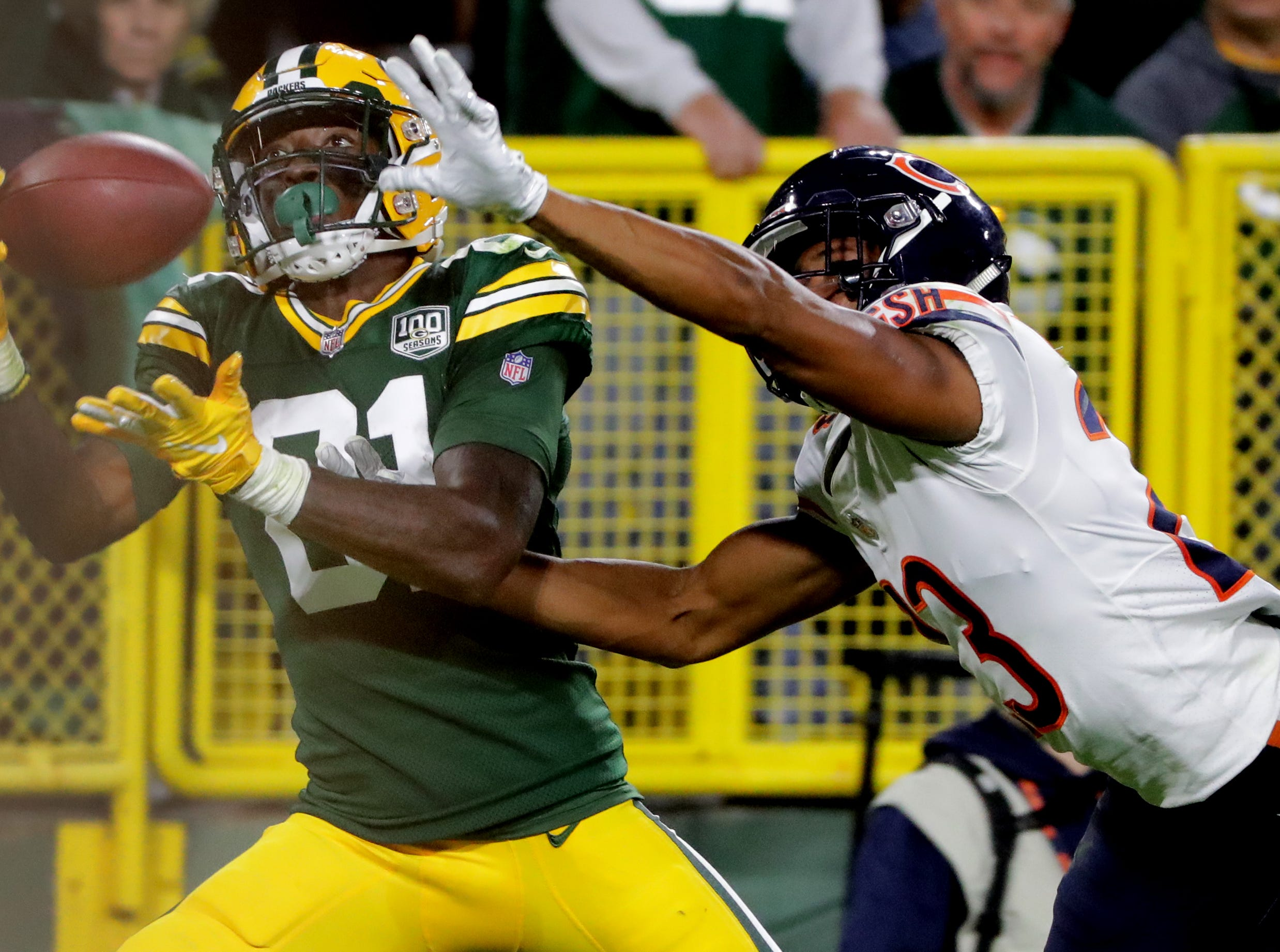 Green Bay Packers wide receiver Geronimo Allison (81) reels in a 39-yard touchdown pass while being covered by Chicago Bears defensive back Kyle Fuller (23) during the fourth quarter Sunday, September 9, 2018 at Lambeau Field in Green Bay, Wis.