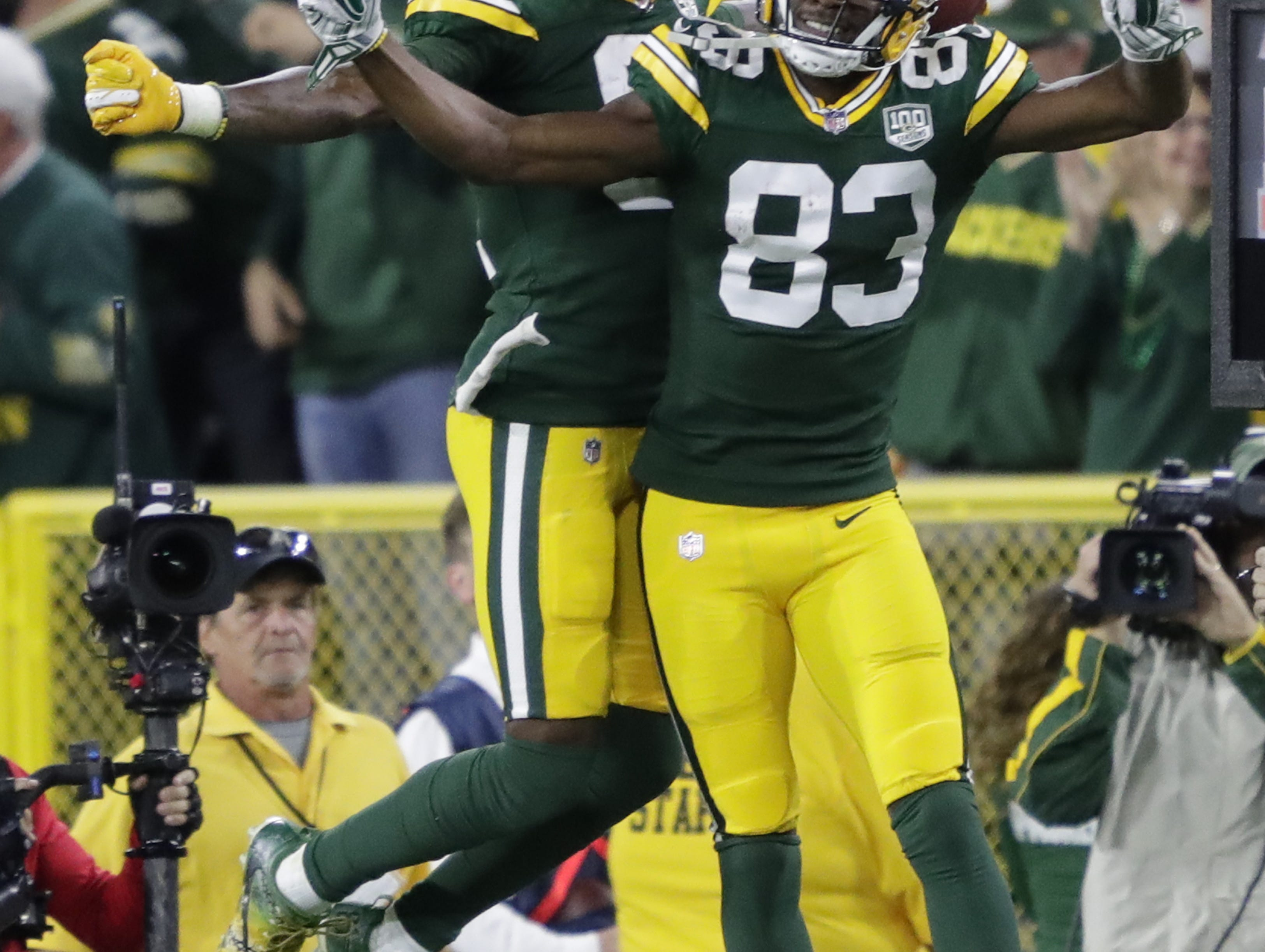 Green Bay Packers wide receiver Geronimo Allison (81) celebrates his touchdown with Marquez Valdes-Scantling (83) in the fourth quarter against the Chicago Bears Sunday, Sept. 9, 2018, at Lambeau Field in Green Bay, Wis.