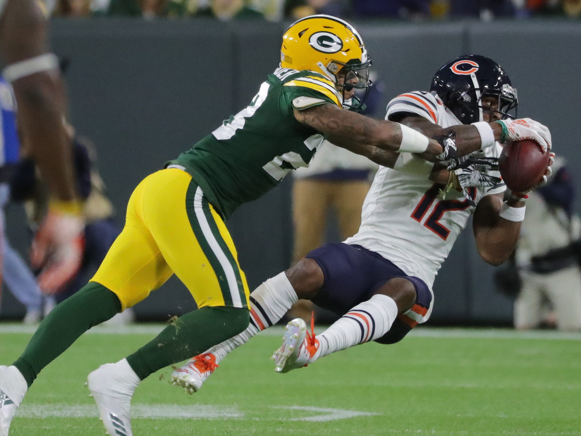 Chicago Bears wide receiver Allen Robinson (12) snares a 33-yard reception while being covered by Green Bay Packers cornerback Jaire Alexander (23) during the first  quarter of their game Sunday, September 9, 2018 at Lambeau Field in Green Bay, Wis.