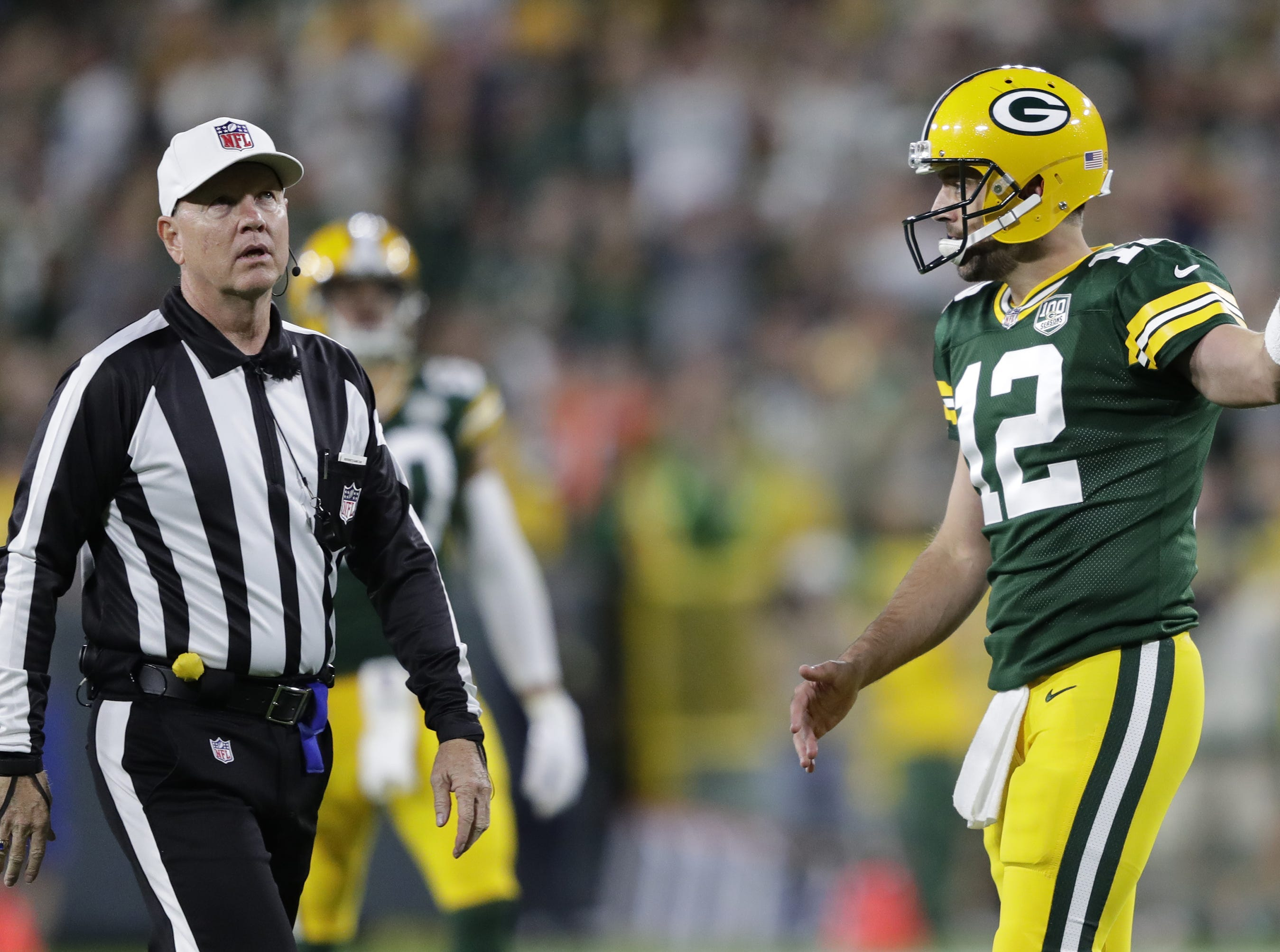 Green Bay Packers quarterback Aaron Rodgers questions an officials call against the offense during the game against the Chicago Bears in the first quarter Sunday, Sept. 9, 2018, at Lambeau Field in Green Bay, Wis.