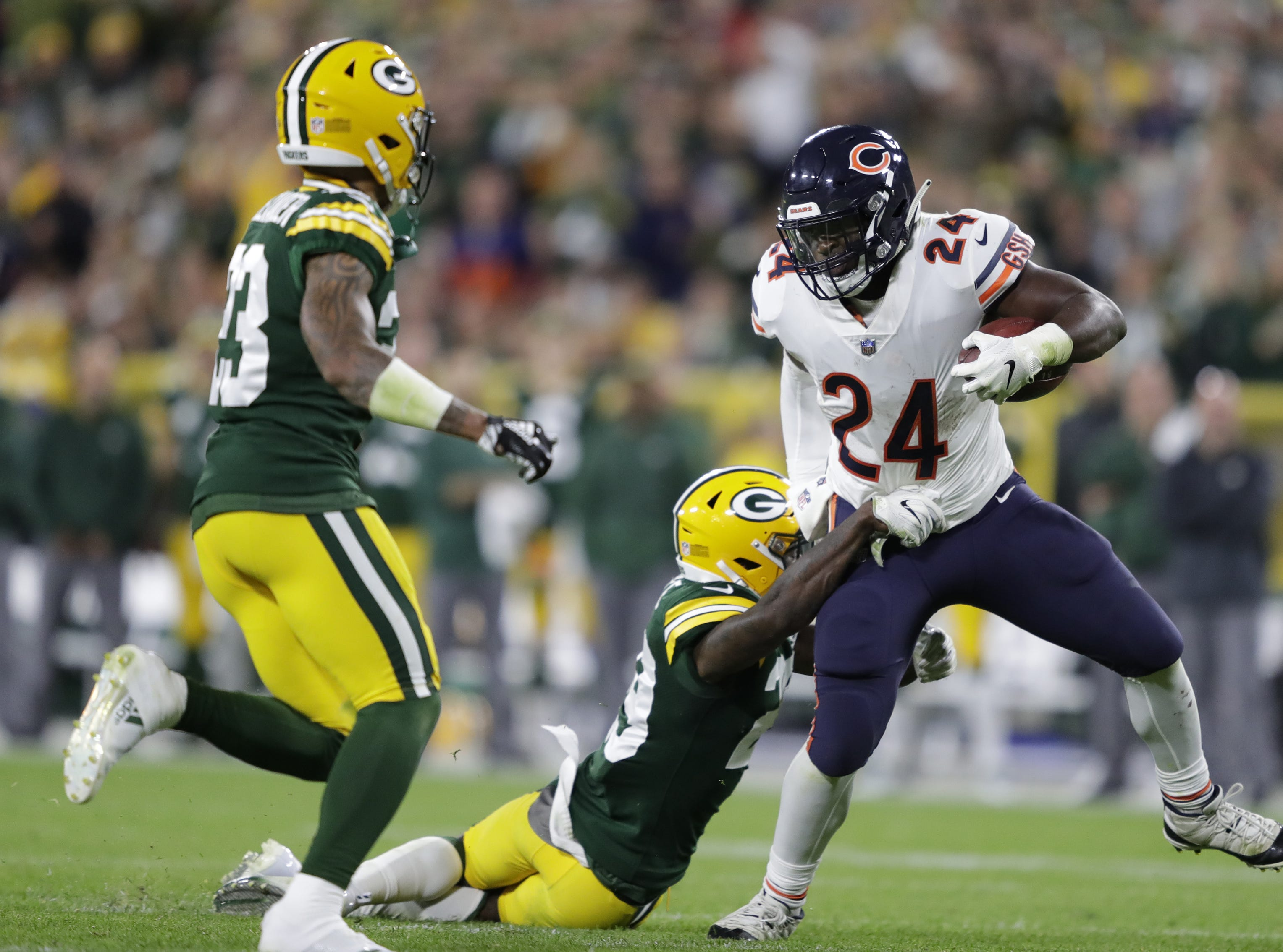 Chicago Bears running back Jordan Howard (24) is tackled by Green Bay Packers defensive back Kentrell Brice (29) in the fourth quarter Sunday, Sept. 9, 2018, at Lambeau Field in Green Bay, Wis.