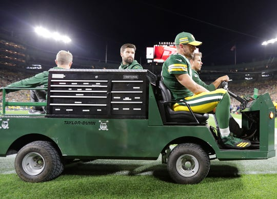 Green Bay Packers' Aaron Rodgers is carted of the field following a second quarter injury against the Chicago Bears in the season opener on Sunday, September 9, 2018, at Lambeau Field in Green Bay, Wis.