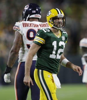 Green Bay Packers quarterback Aaron Rodgers (12) winces in pain late in the fourth quarter against the Chicago Bears Sunday, Sept. 9, 2018, at Lambeau Field in Green Bay, Wis.