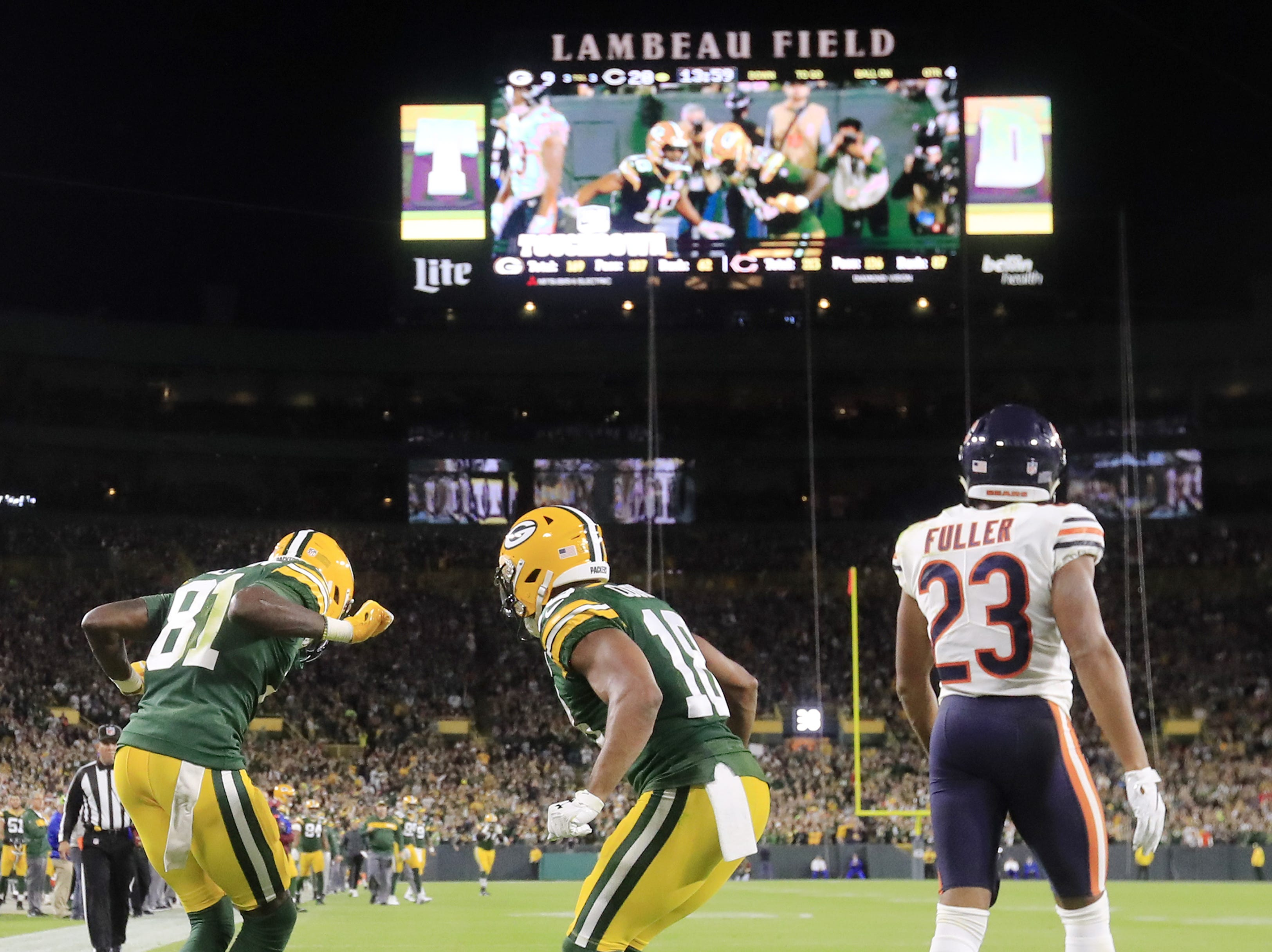 Green Bay Packers wide receiver Geronimo Allison (81) and wide receiver Randall Cobb (18) dance after a 39-yard touchdown by Allison against the Chicago Bears in the fourth quarter at Lambeau Field on Sunday, September 9, 2018 in Green Bay, Wis.
