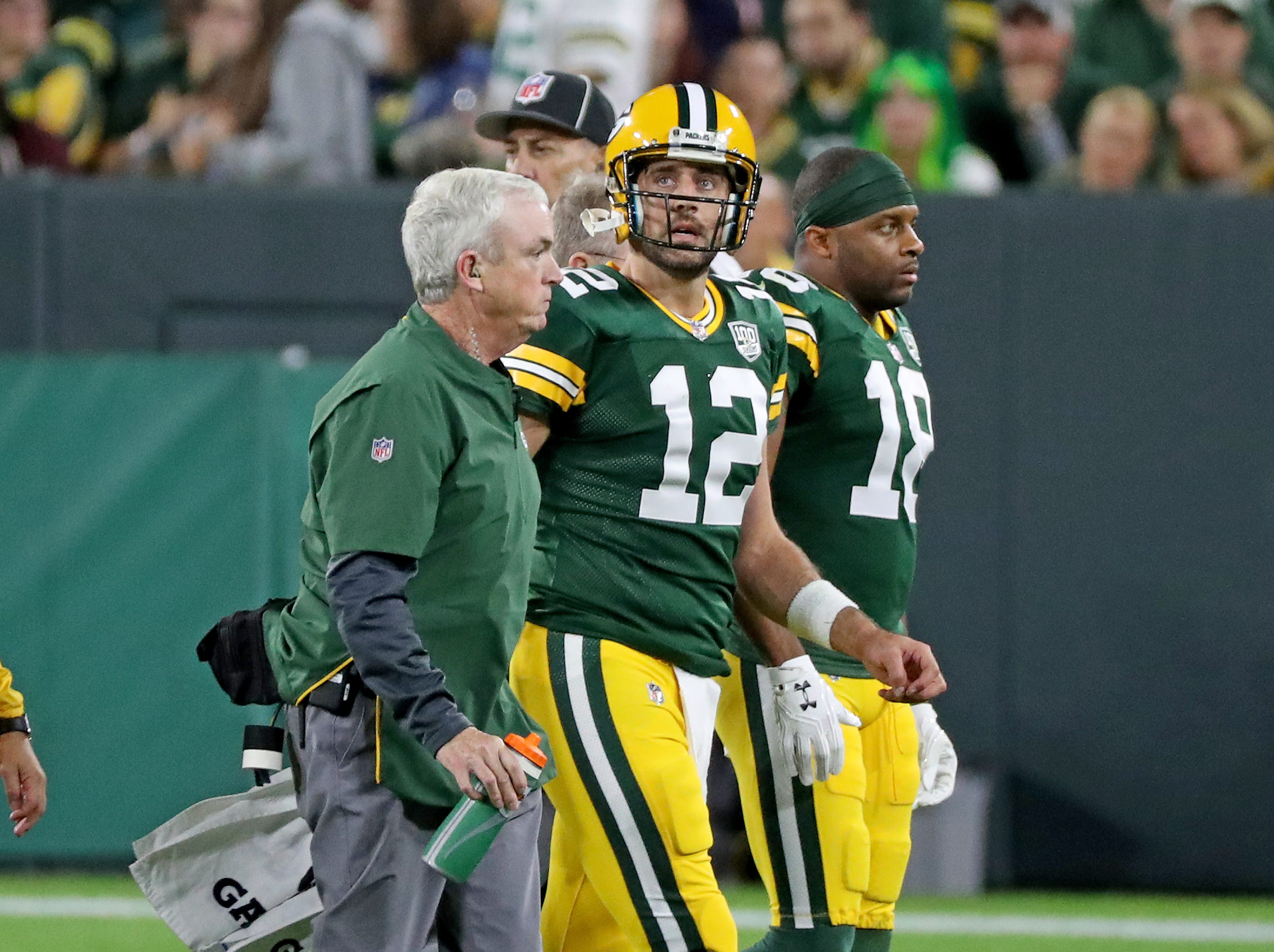 Green Bay Packers quarterback Aaron Rodgers (12) walks off the field after being injured against the Chicago Bears Sunday, September 9, 2018 at Lambeau Field in Green Bay, Wis. Jim Matthews/USA TODAY NETWORK-Wisconsin