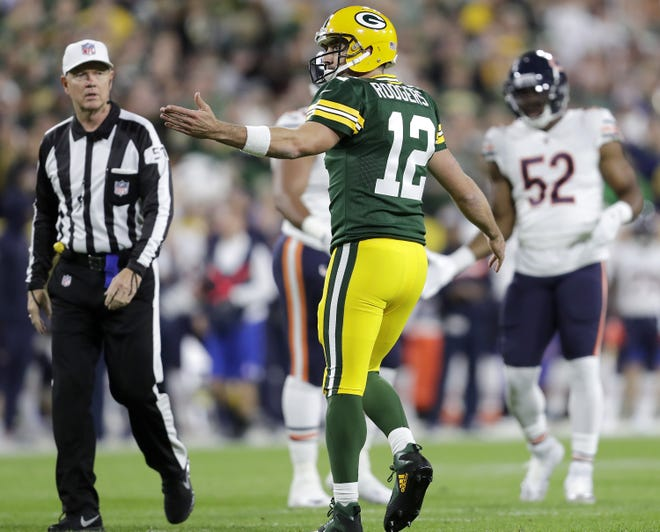 Green Bay Packers' Aaron Rodgers argues a call in the first half against the Chicago Bears in the season opener on Sunday, September 9, 2018, at Lambeau Field in Green Bay, Wis. The Packers defeated the Bears 24 to 23.