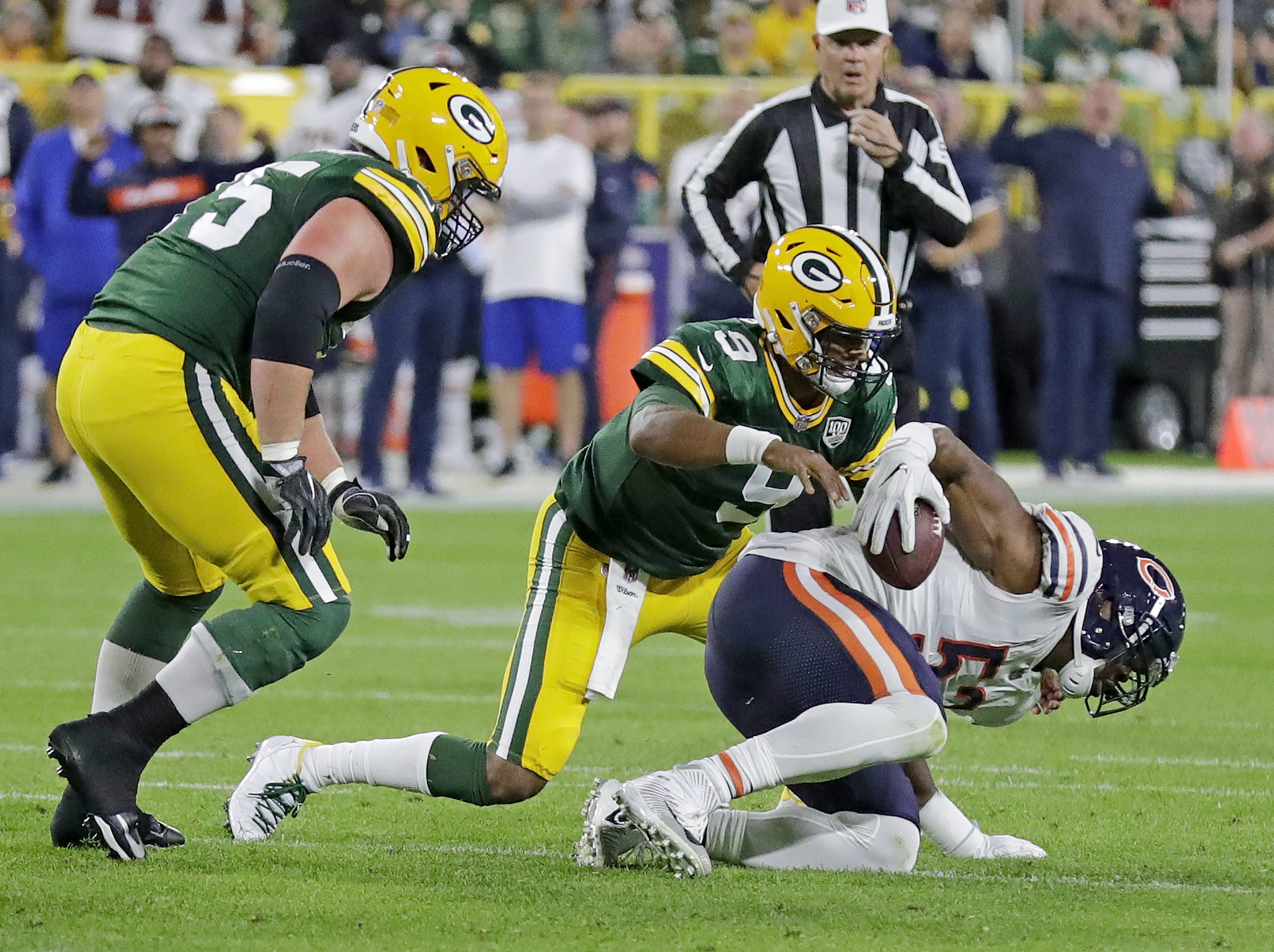 Green Bay Packers quarterback DeShone Kizer (9) loses the ball to linebacker Khalil Mack (52) against the Chicago Bears Sunday, September 9, 2018 at Lambeau Field in Green Bay, Wis.