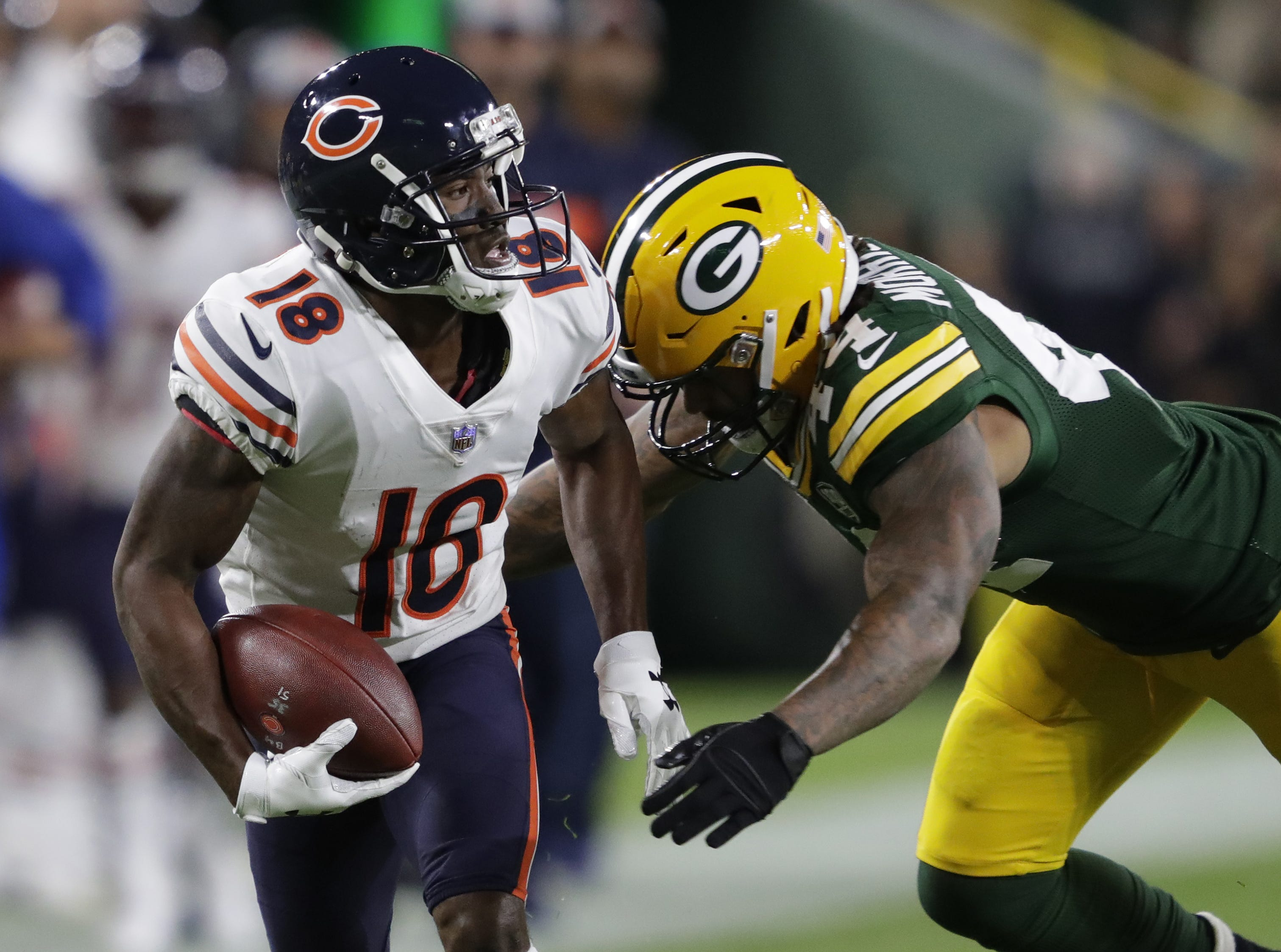 Chicago Bears wide receiver Taylor Gabriel (18) breaks away for a long pass reception against Green Bay Packers linebacker Antonio Morrison (44) in the first quarter Sunday, Sept. 9, 2018, at Lambeau Field in Green Bay, Wis.