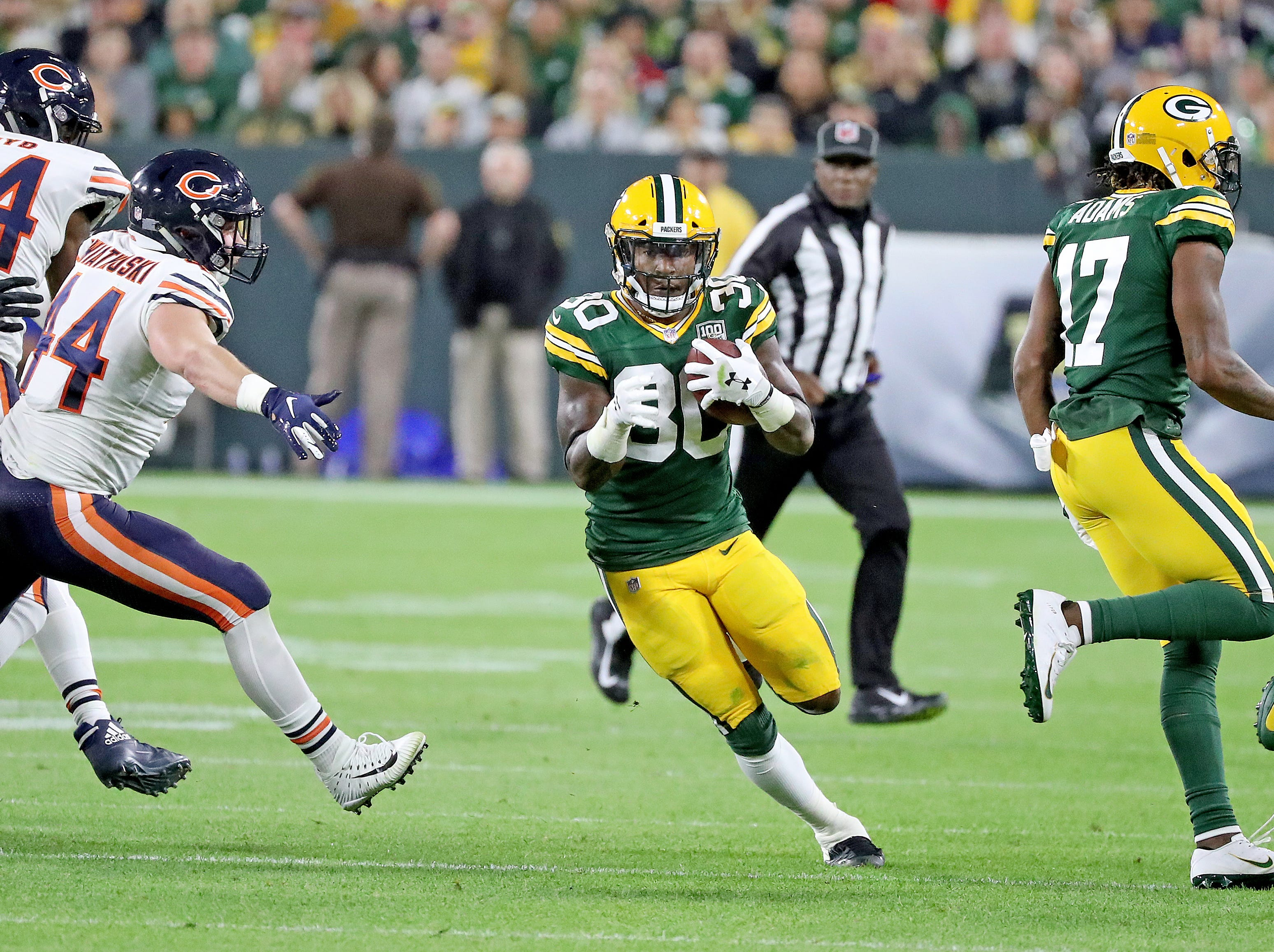 Green Bay Packers running back Jamaal Williams (30) runs against the Chicago Bears Sunday, September 9, 2018 at Lambeau Field in Green Bay, Wis.