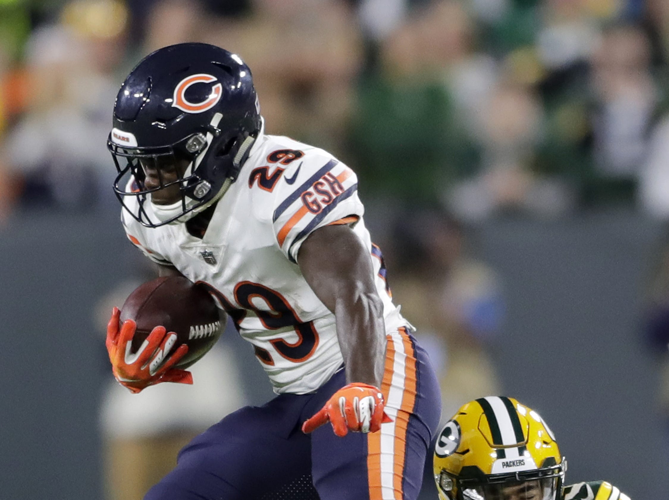 Green Bay Packers cornerback Jaire Alexander (23) tackles Chicago Bears running back Tarik Cohen (29) in the fourth quarter at Lambeau Field on Sunday, September 9, 2018 in Green Bay, Wis.