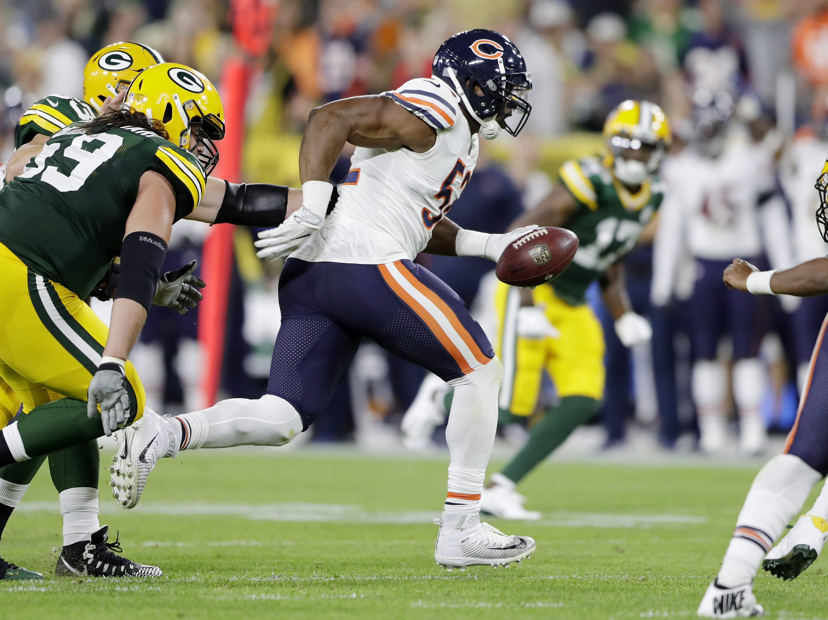 Chicago Bears linebacker Khalil Mack (52) scores a touchdown against the Green Bay Packers in the second quarter at Lambeau Field on Sunday, September 9, 2018 in Green Bay, Wis.