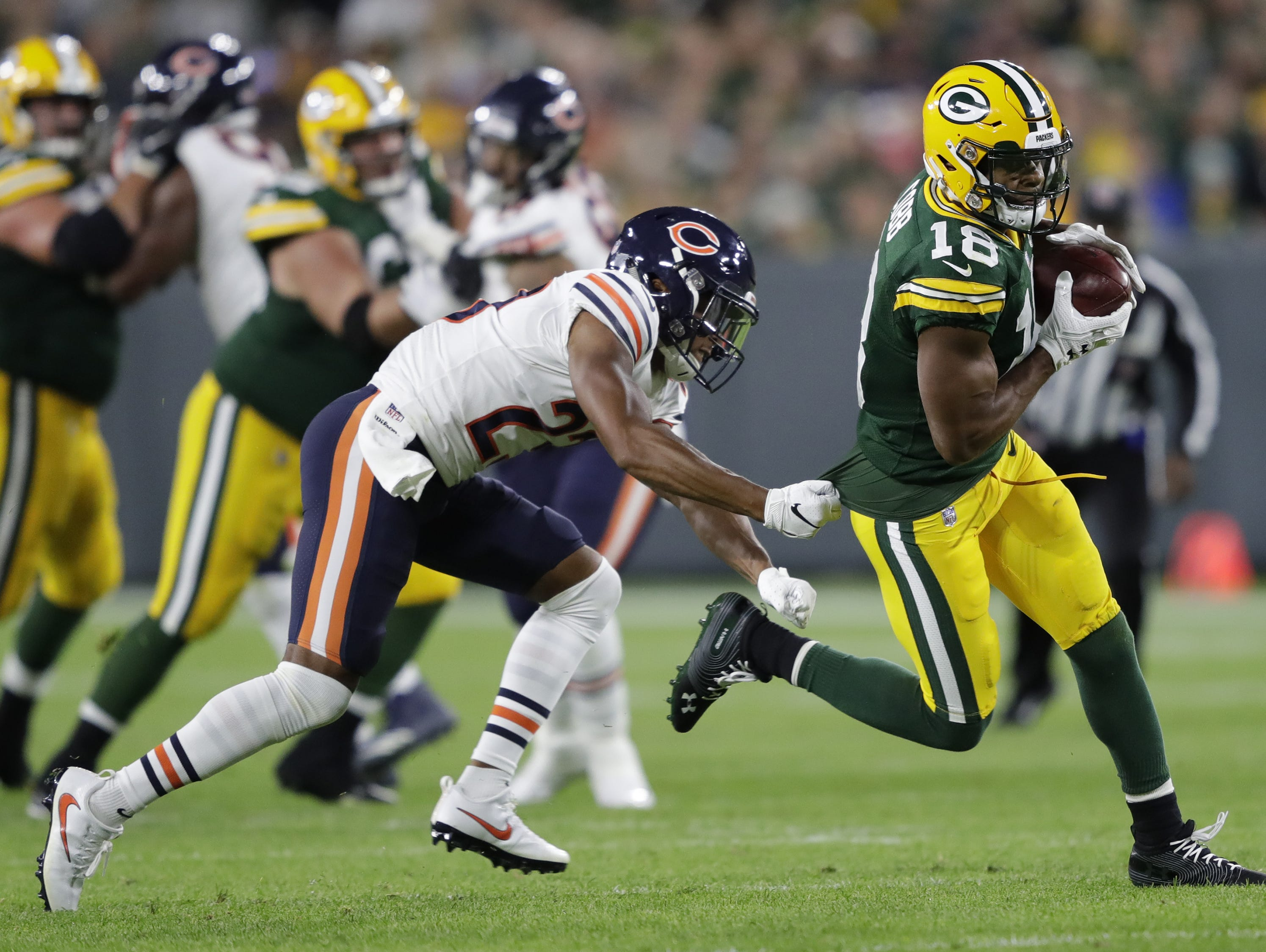 Green Bay Packers wide receiver Randall Cobb (18) runs for a first down against Chicago Bears defensive back Kyle Fuller (23) in the second half Sunday, Sept. 9, 2018, at Lambeau Field in Green Bay, Wis.