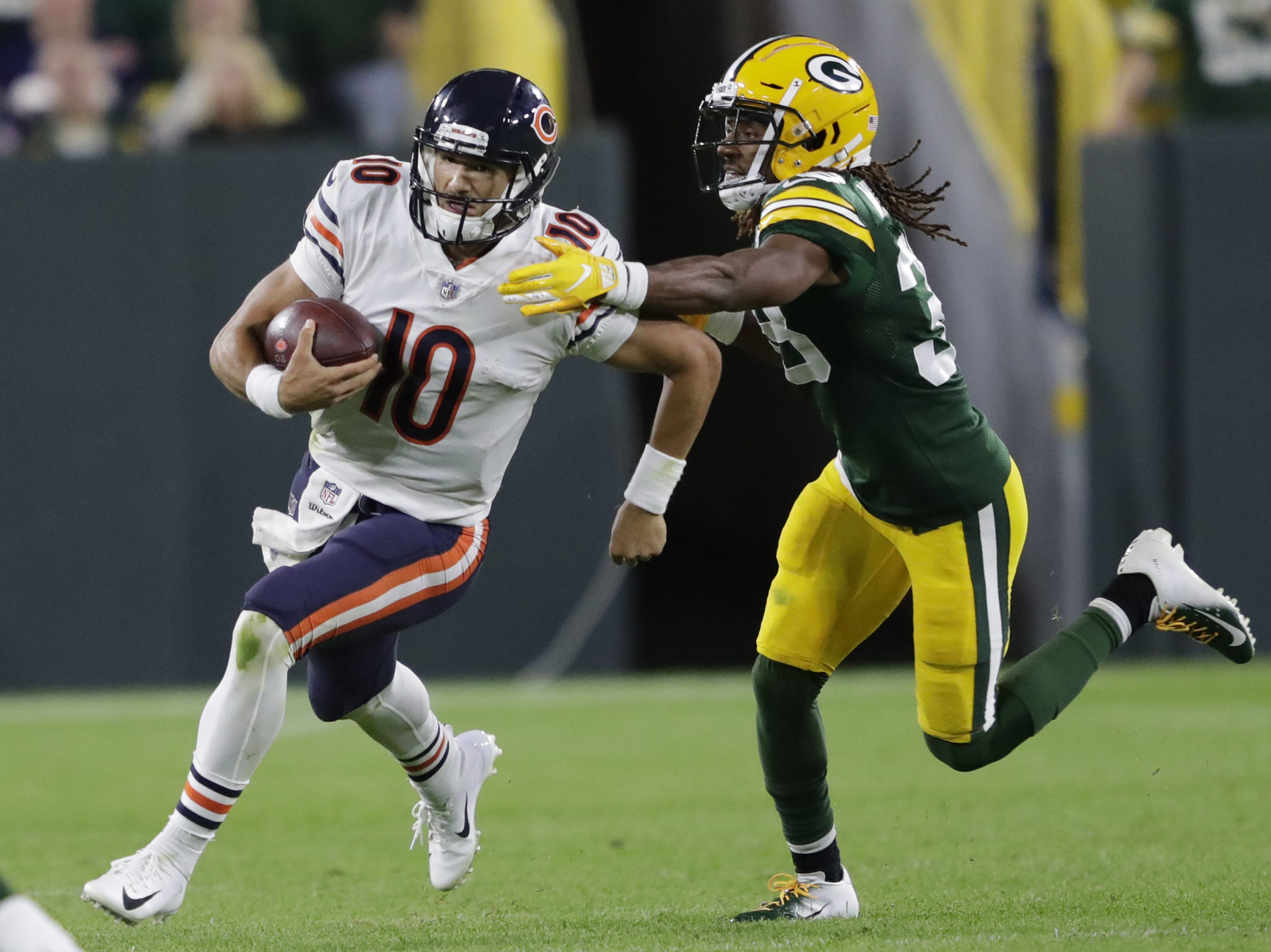 Chicago Bears quarterback Mitchell Trubisky runs for yardage against Green Bay Packers defensive back Tramon Williams (38) in the fourth quarter Sunday, Sept. 9, 2018, at Lambeau Field in Green Bay, Wis.