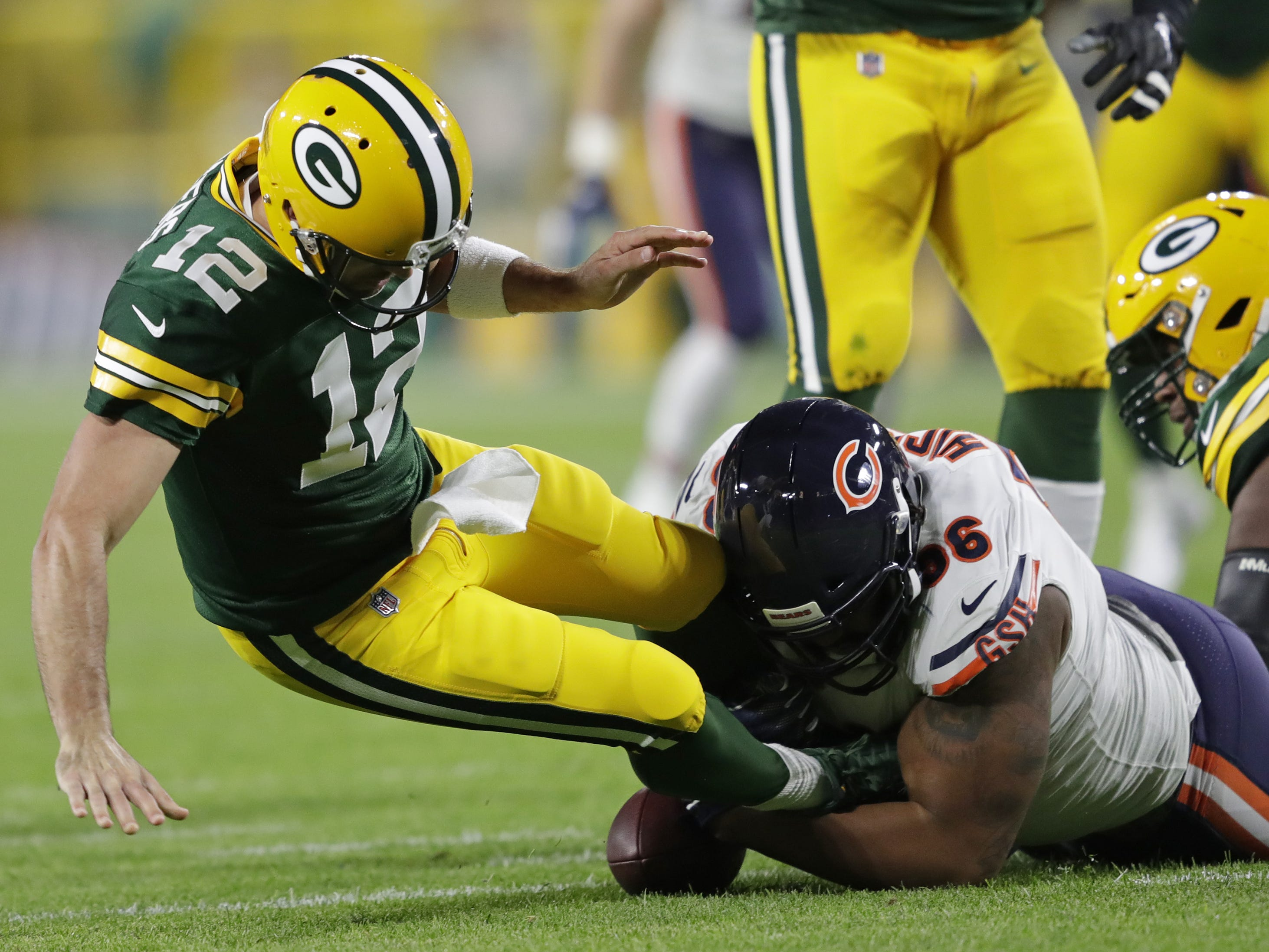 Green Bay Packers quarterback Aaron Rodgers (12) is sacked by Chicago Bears defensive end Akiem Hicks (96) in the first quarter Sunday, Sept. 9, 2018, at Lambeau Field in Green Bay, Wis.