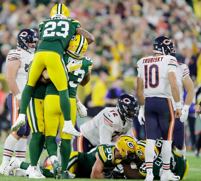 Green Bay Packers cornerback Jaire Alexander (23) celebrates with linebacker Nick Perry (53) after a Chicago Bears fumble in the fourth quarter at Lambeau Field on Sunday, September 9, 2018 in Green Bay, Wis.Adam Wesley/USA TODAY NETWORK-Wisconsin