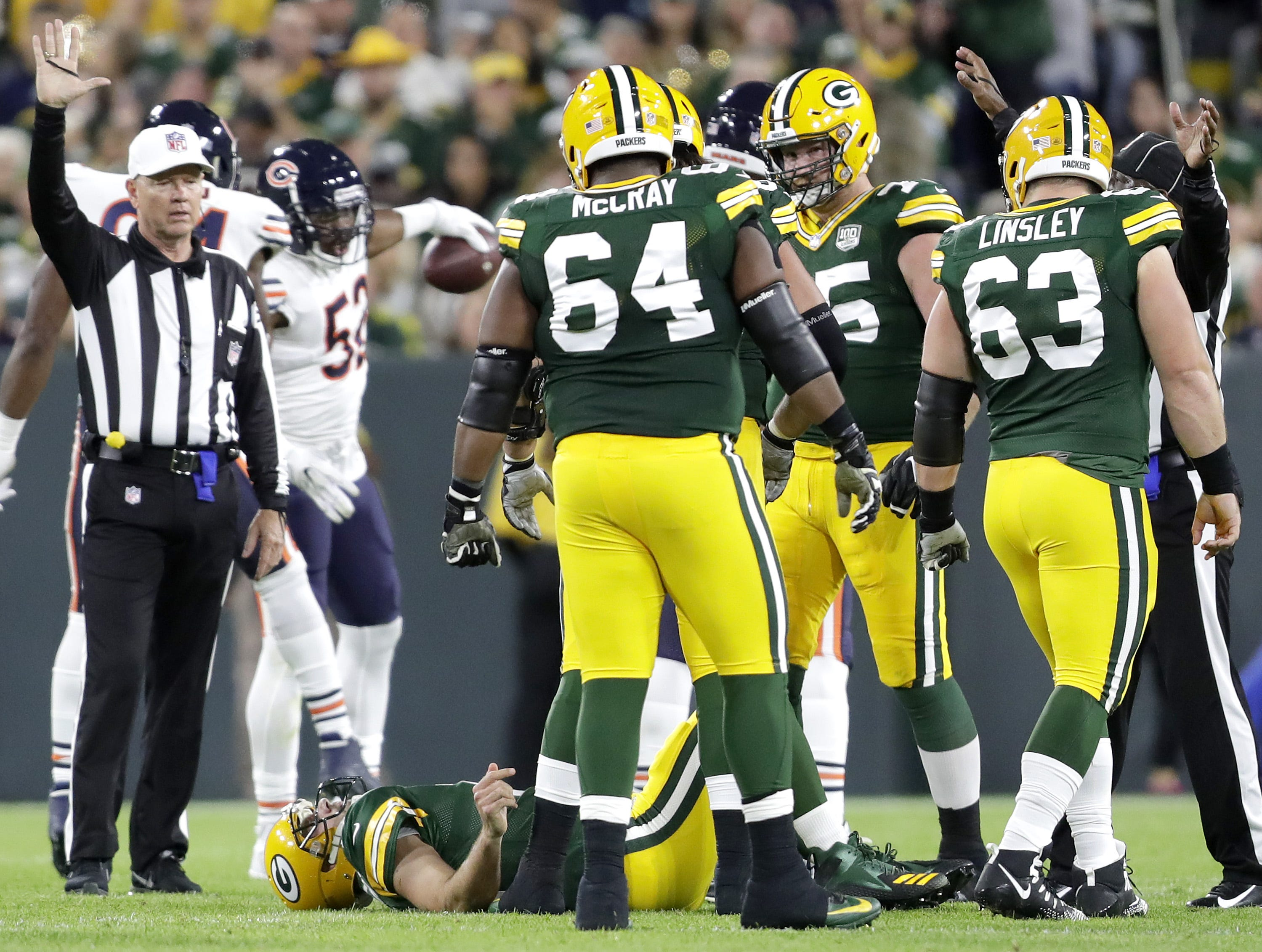 Green Bay Packers' Aaron Rodgers is injured in the second quarter against the Chicago Bears in the season opener on Sunday, September 9, 2018, at Lambeau Field in Green Bay, Wis.