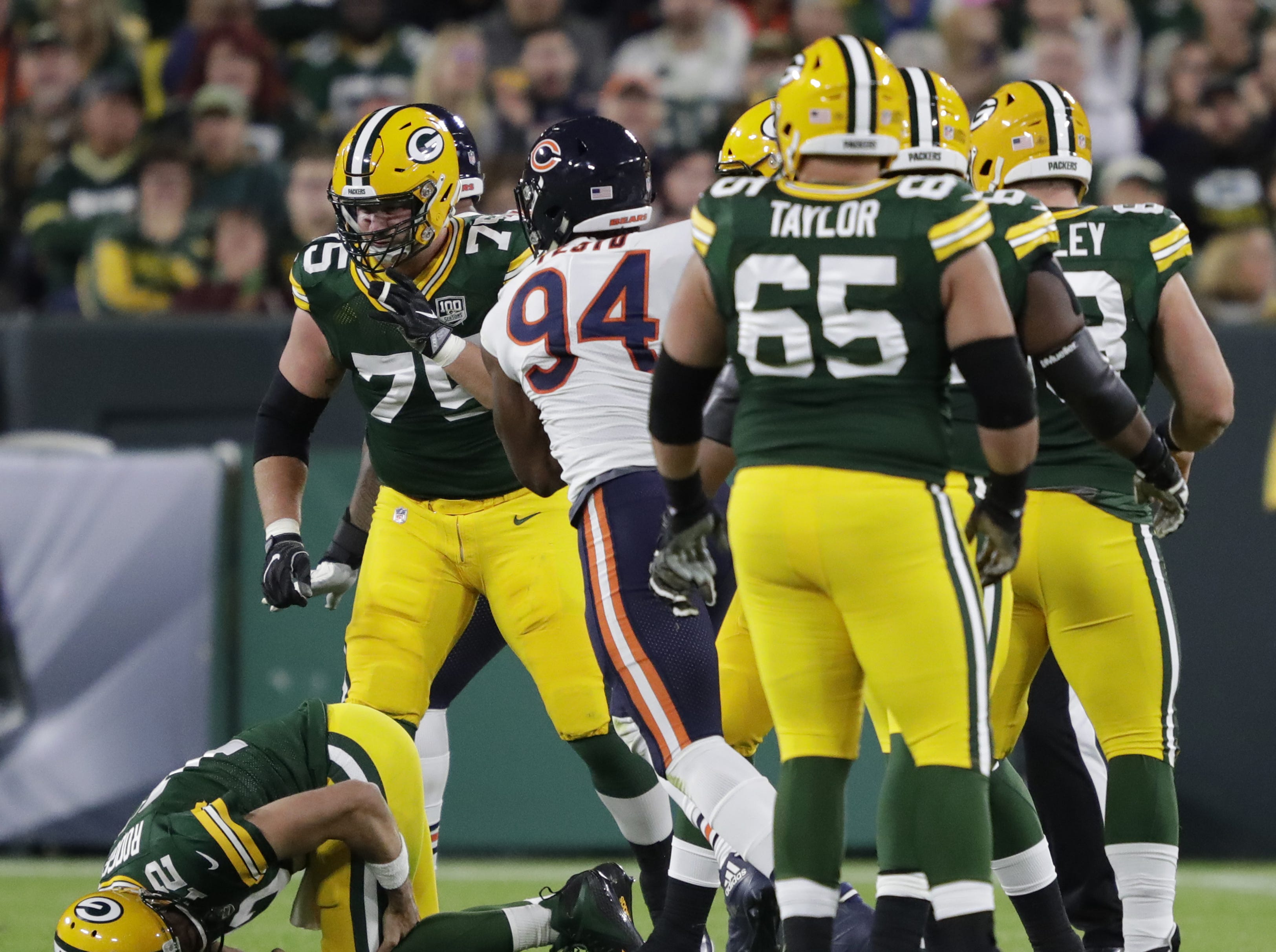 Green Bay Packers quarterback Aaron Rodgers (12) is injured during the second quarter against the Chicago Bears Sunday, Sept. 9, 2018, at Lambeau Field in Green Bay, Wis.