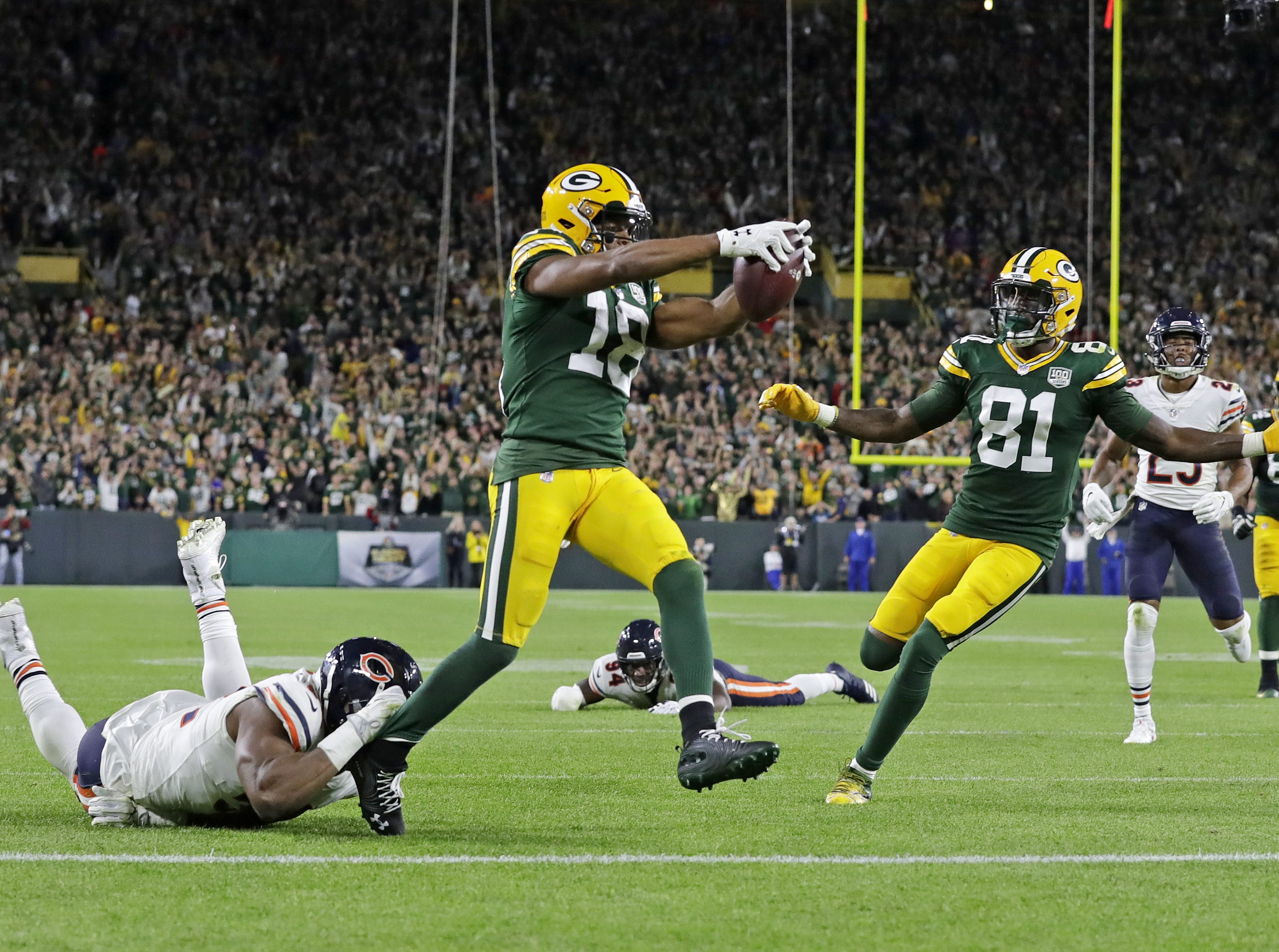 Green Bay Packers wide receiver Randall Cobb (18) scores a 75-yard touchdown against the Chicago Bears in the fourth quarter at Lambeau Field on Sunday, September 9, 2018 in Green Bay, Wis.