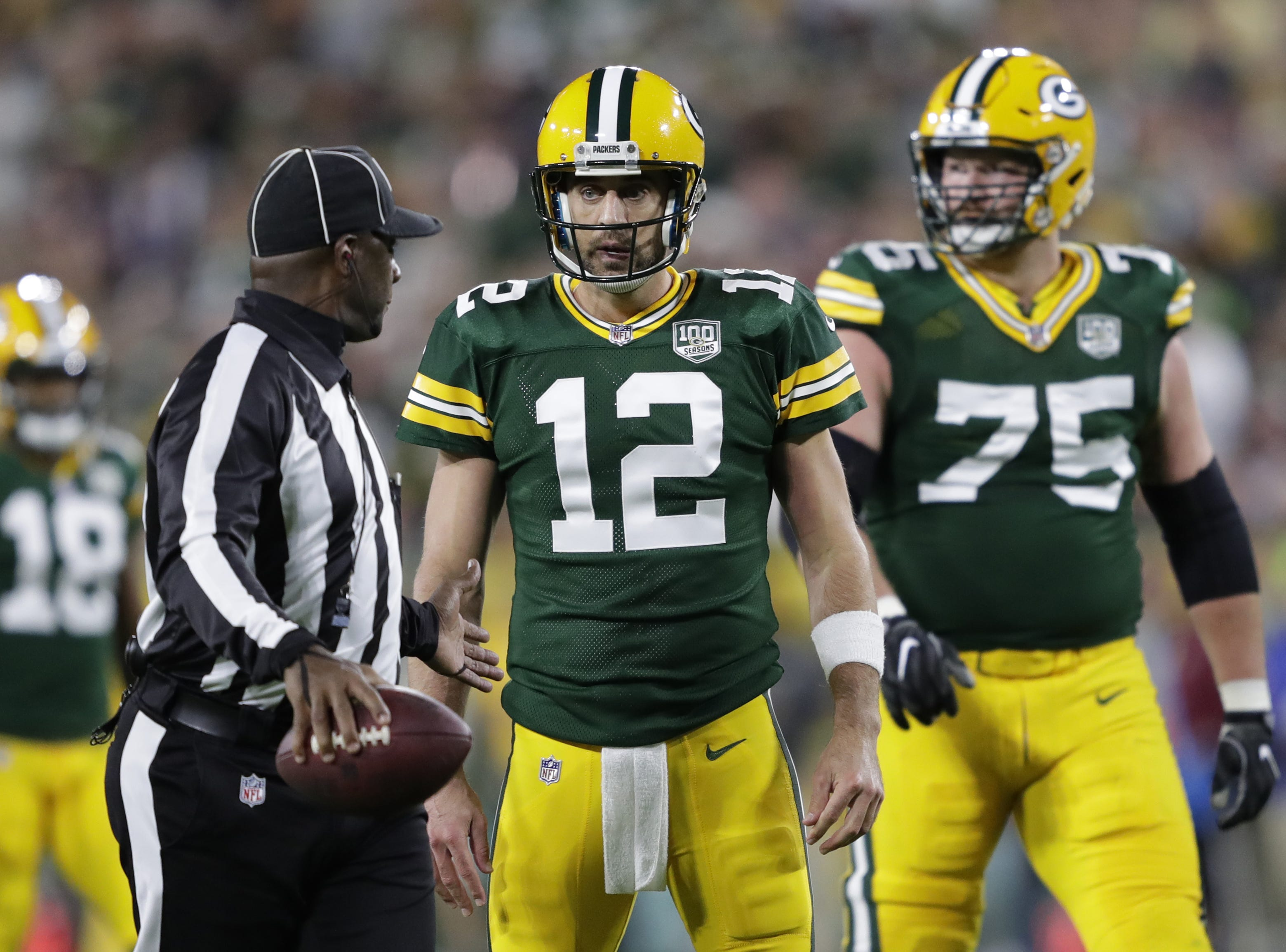 Green Bay Packers quarterback Aaron Rodgers (12) questions a call by an official against the Chicago Bears Sunday, Sept. 9, 2018, at Lambeau Field in Green Bay, Wis.