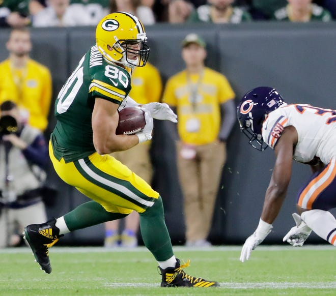 Green Bay Packers tight end Jimmy Graham (80) runs after a catch against the Chicago Bears in the first quarter at Lambeau Field on Sunday, September 9, 2018 in Green Bay, Wis.