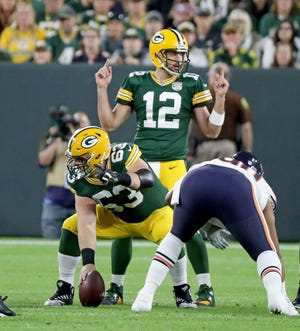 History says that if quarterback Aaron Rodgers stays on the field, the Packers will win at least 10 games and be in the playoffs.