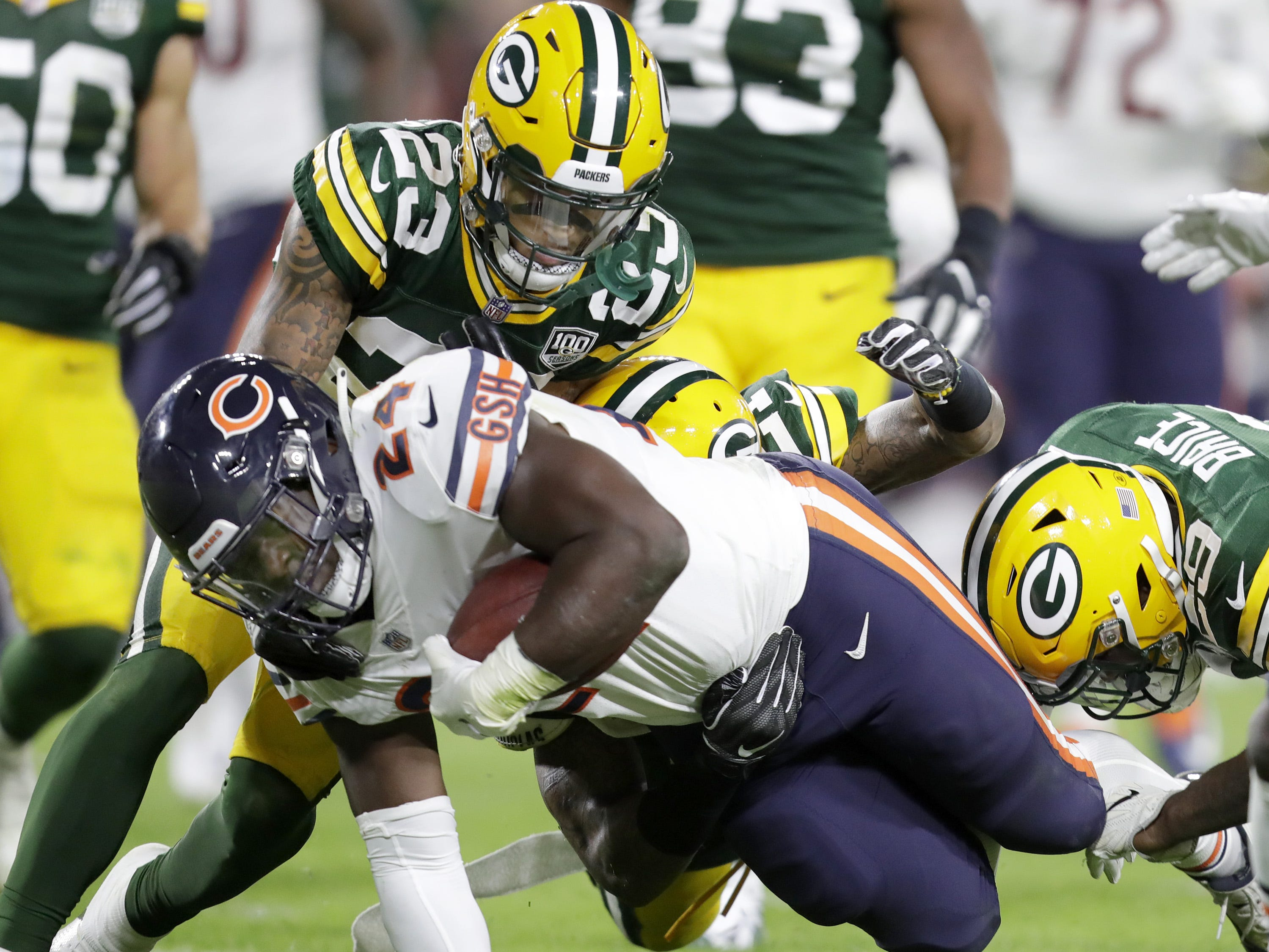 Chicago Bears' Jordan Howard rushes against Green Bay Packers' Jaire Alexander, Ha Ha Clinton-Dix and Kentrell Brice in the season opener on Sunday, September 9, 2018, at Lambeau Field in Green Bay, Wis. The Packers defeated the Bears 24 to 23.