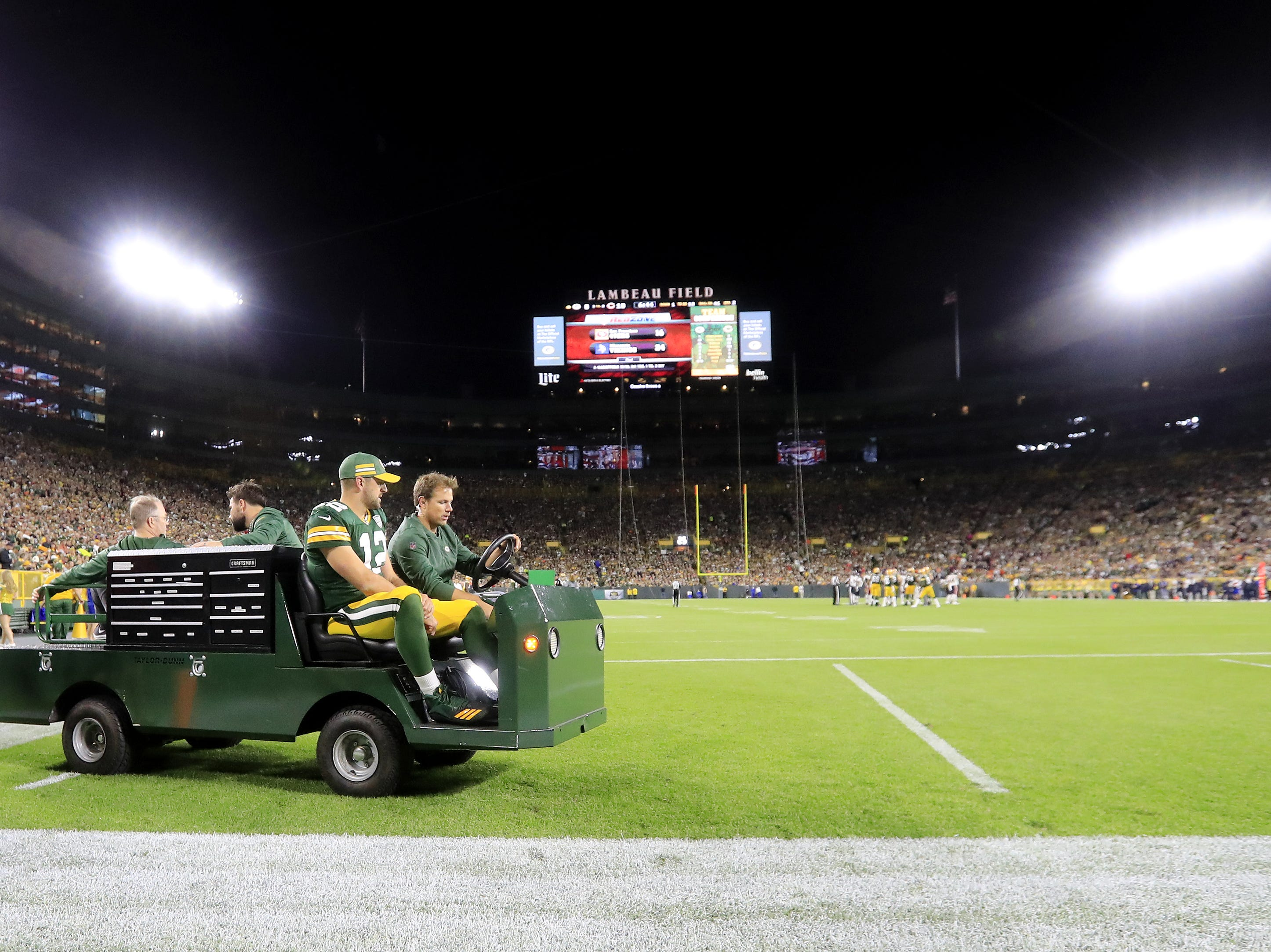 Green Bay Packers quarterback Aaron Rodgers (12) is taken off the field after sustaining an injury in the second quarter against the Chicago Bears at Lambeau Field on Sunday, September 9, 2018 in Green Bay, Wis.