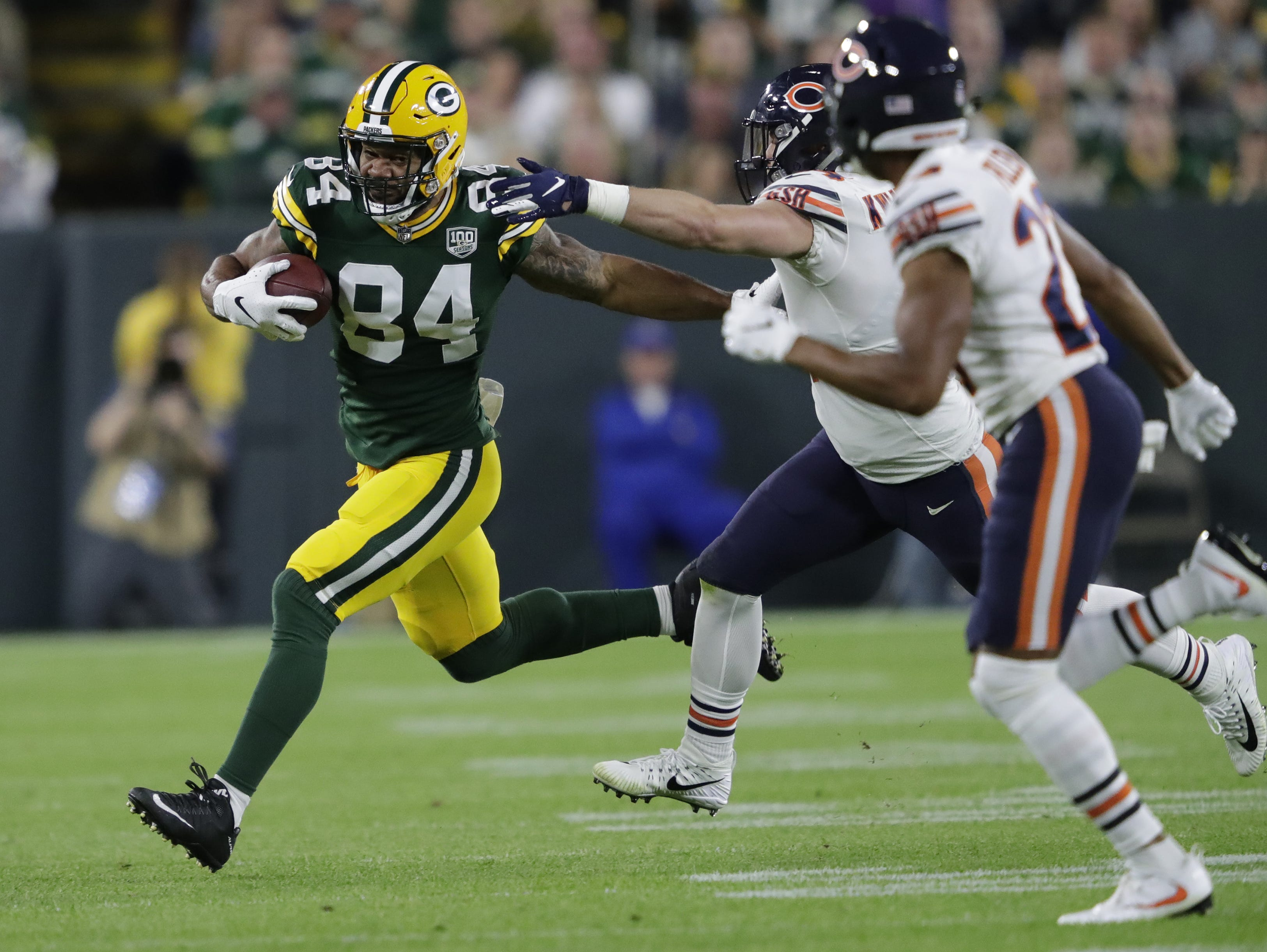 Green Bay Packers tight end Lance Kendricks (84) runs for a first down against the Chicago Bears Sunday, Sept. 9, 2018, at Lambeau Field in Green Bay, Wis.