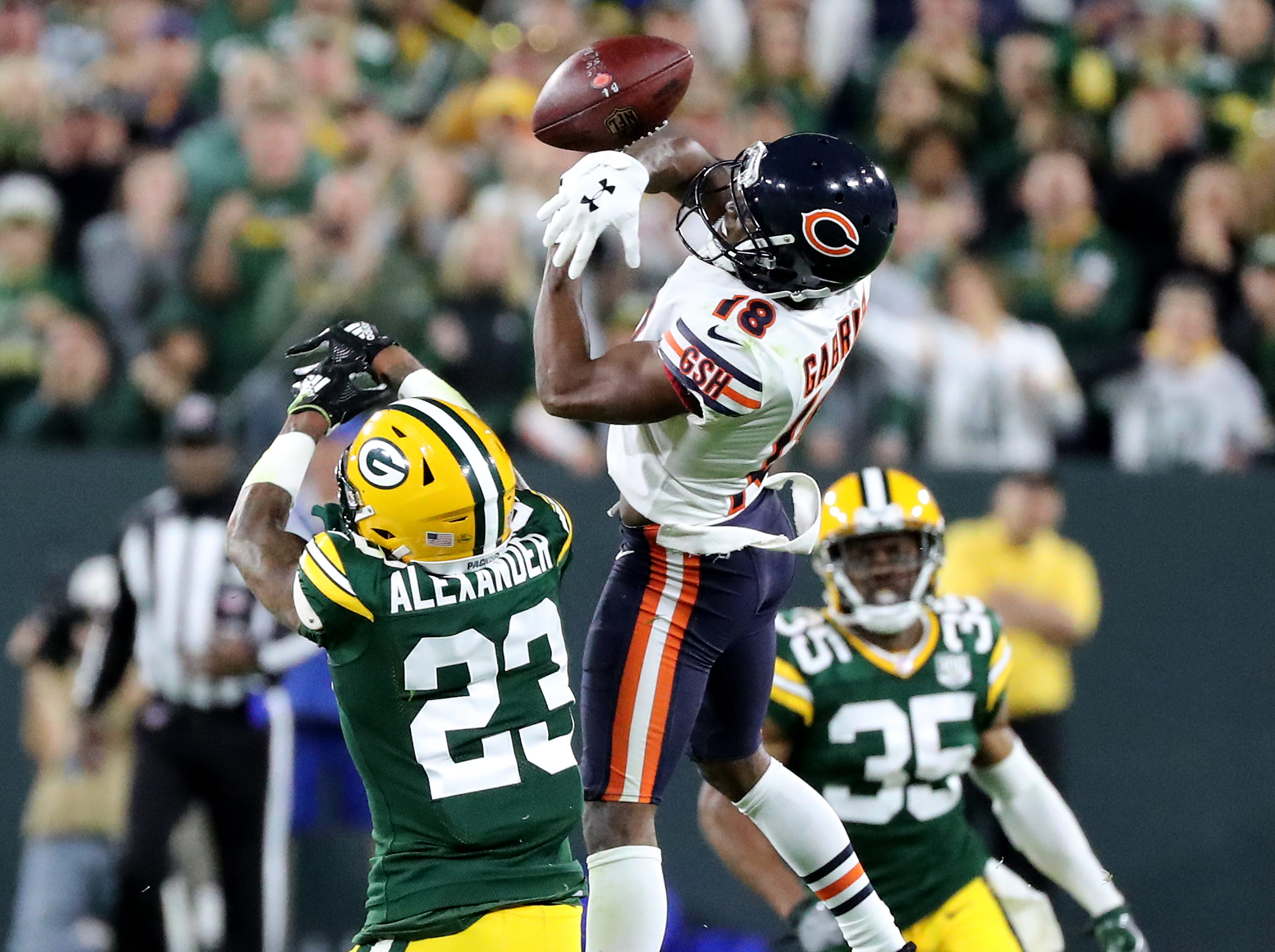 Green Bay Packers cornerback Jaire Alexander (23) defends a pass to wide receiver Taylor Gabriel (18) in the fourth quarter against the Chicago Bears Sunday, September 9, 2018 at Lambeau Field in Green Bay, Wis.