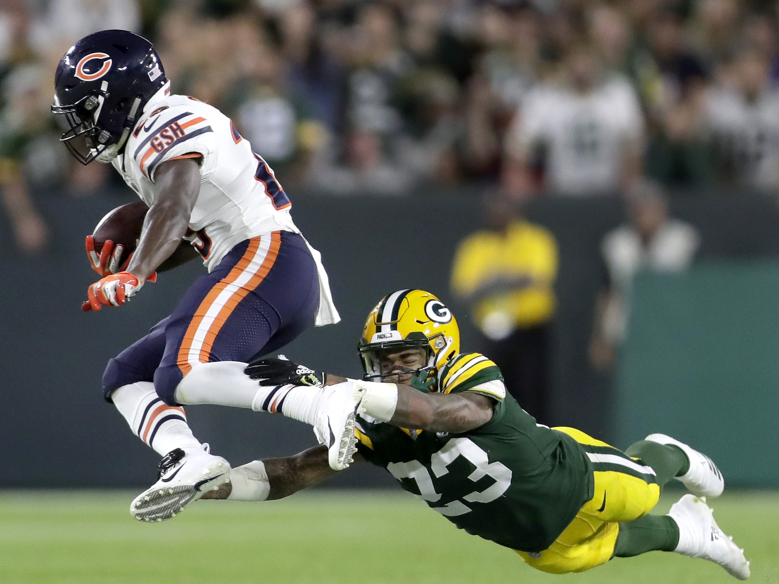 Green Bay Packers' Jaire Alexander against Chicago Bears' Tarik Cohen in the fourth quarter of the season opener on Sunday, September 9, 2018, at Lambeau Field in Green Bay, Wis. The Packers defeated the Bears 24 to 23.