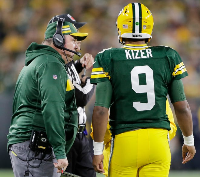 Green Bay Packers head coach Mike McCarthy talks to quarterback DeShone Kizer (9) in the second quarter against the Chicago Bears at Lambeau Field on Sunday, September 9, 2018 in Green Bay, Wis.Adam Wesley/USA TODAY NETWORK-Wisconsin